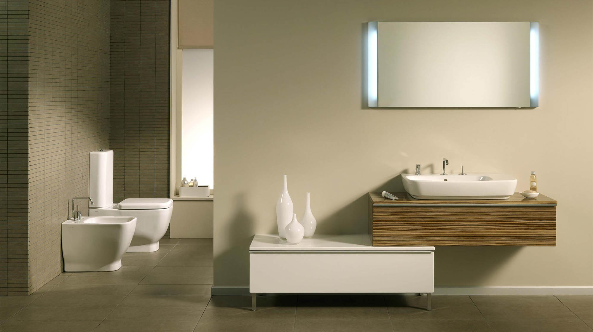 Matching bidet and toilet in this beautiful modern master bathroom.