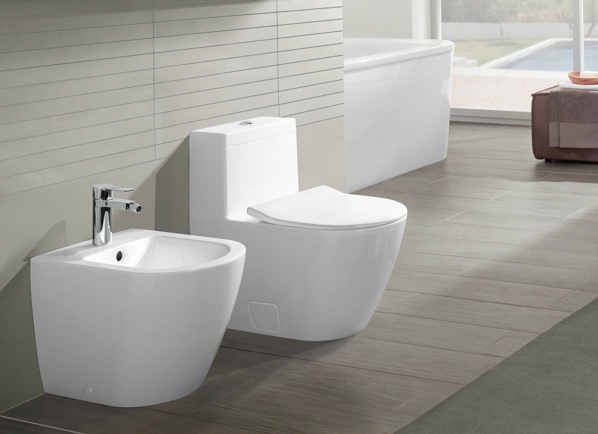 matching side by side white ceramic floor mounted toilet and bidet