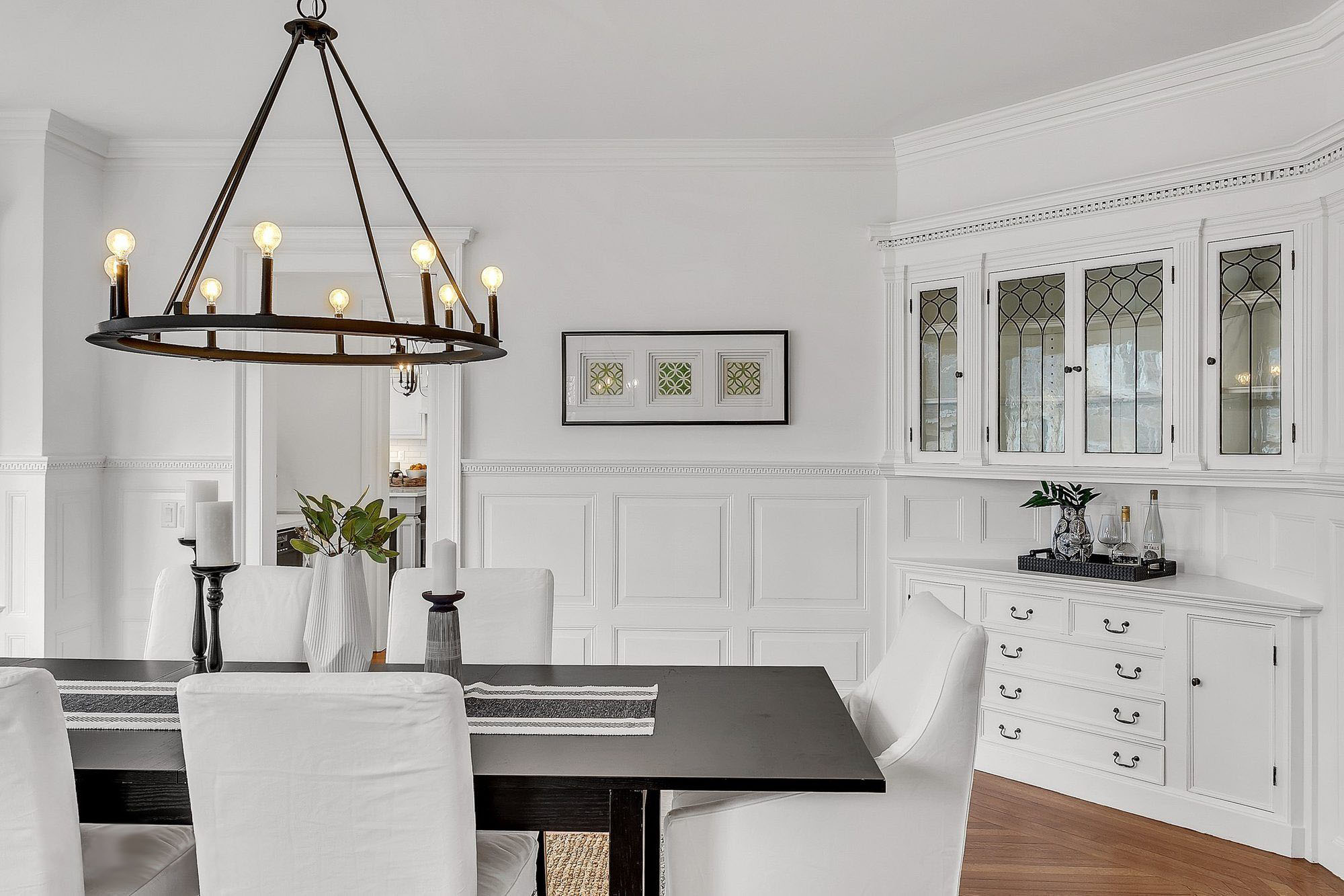 all white monochromatic dining room color scheme with black accessory colors.
