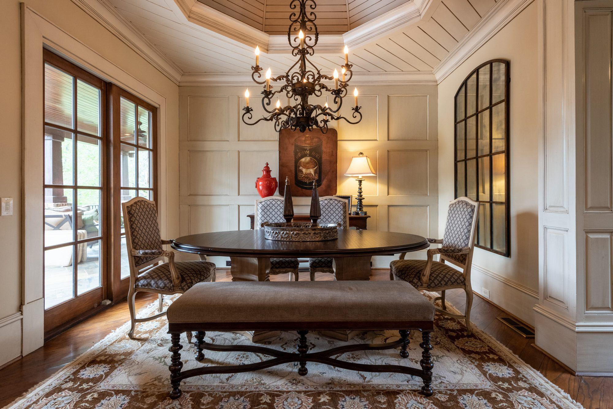 traditionally styles area rug in a dining room brown, cream and tan colors with wood furniture