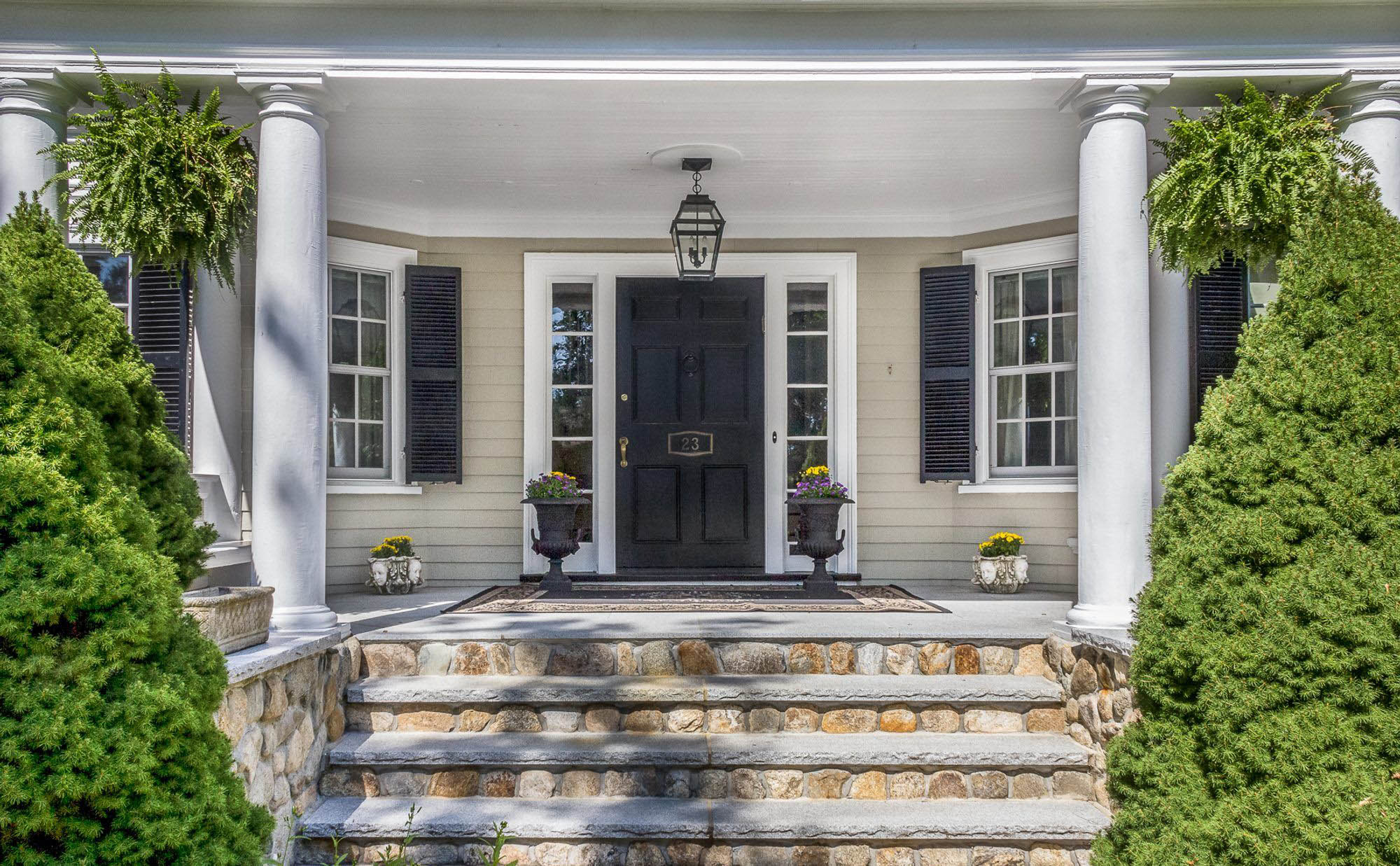 charming front porch design real stone steps with limestone black front door.