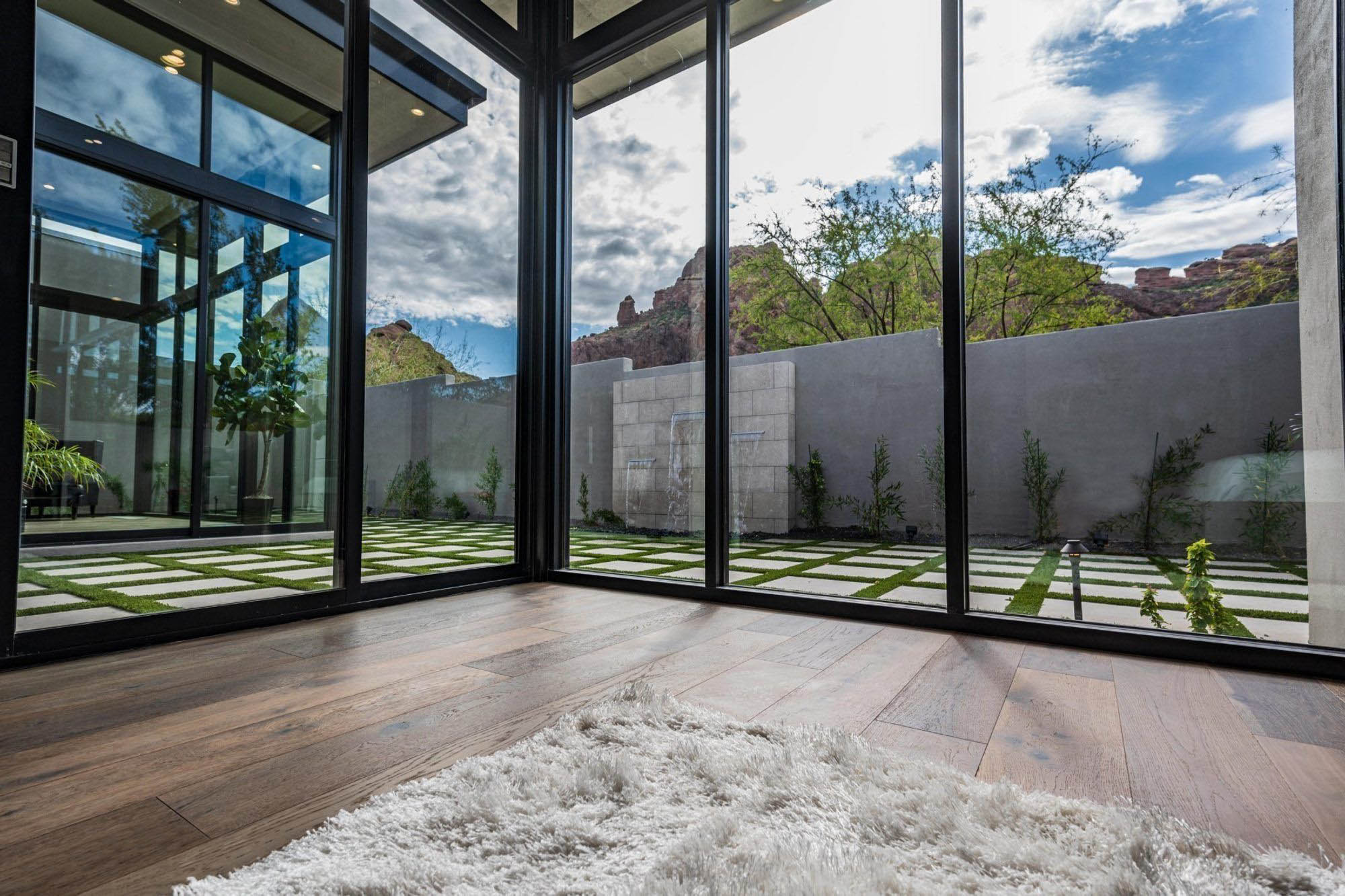 modern style area rug in a modern home with huge walls of glass