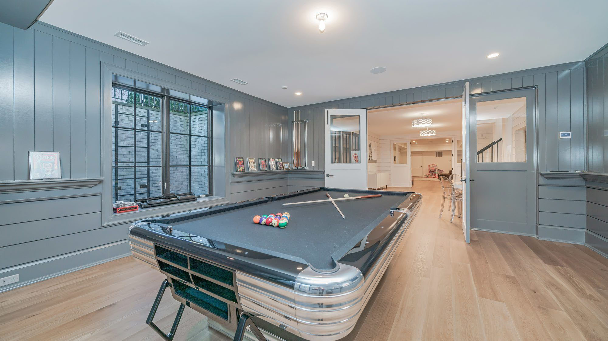 Blue gray game room with matching pool table felt.