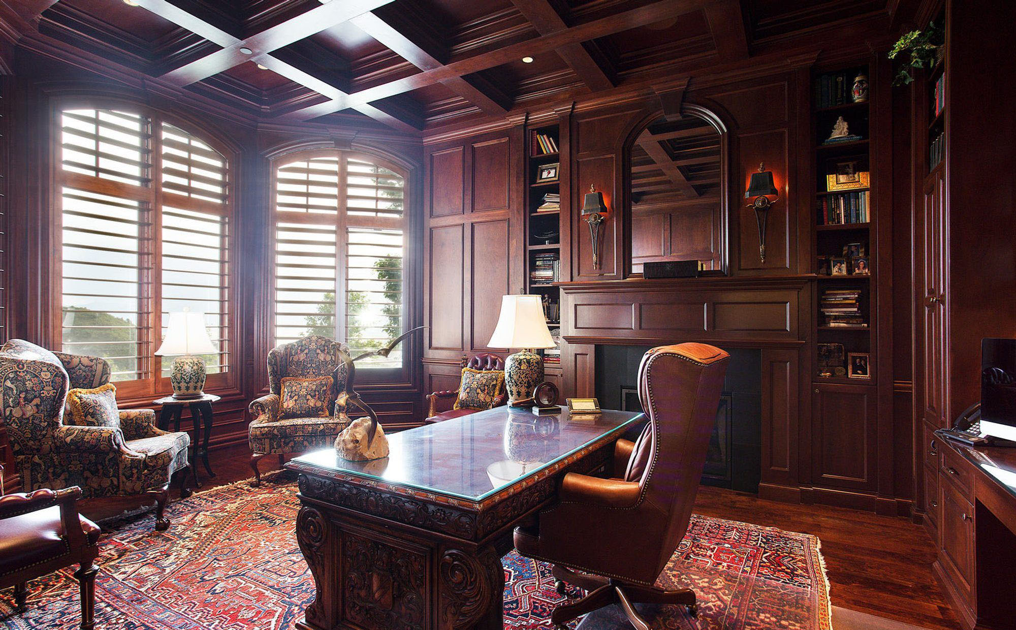 rich red wood monochromatic stained wood design home office with all wood wall paneling and ceiling