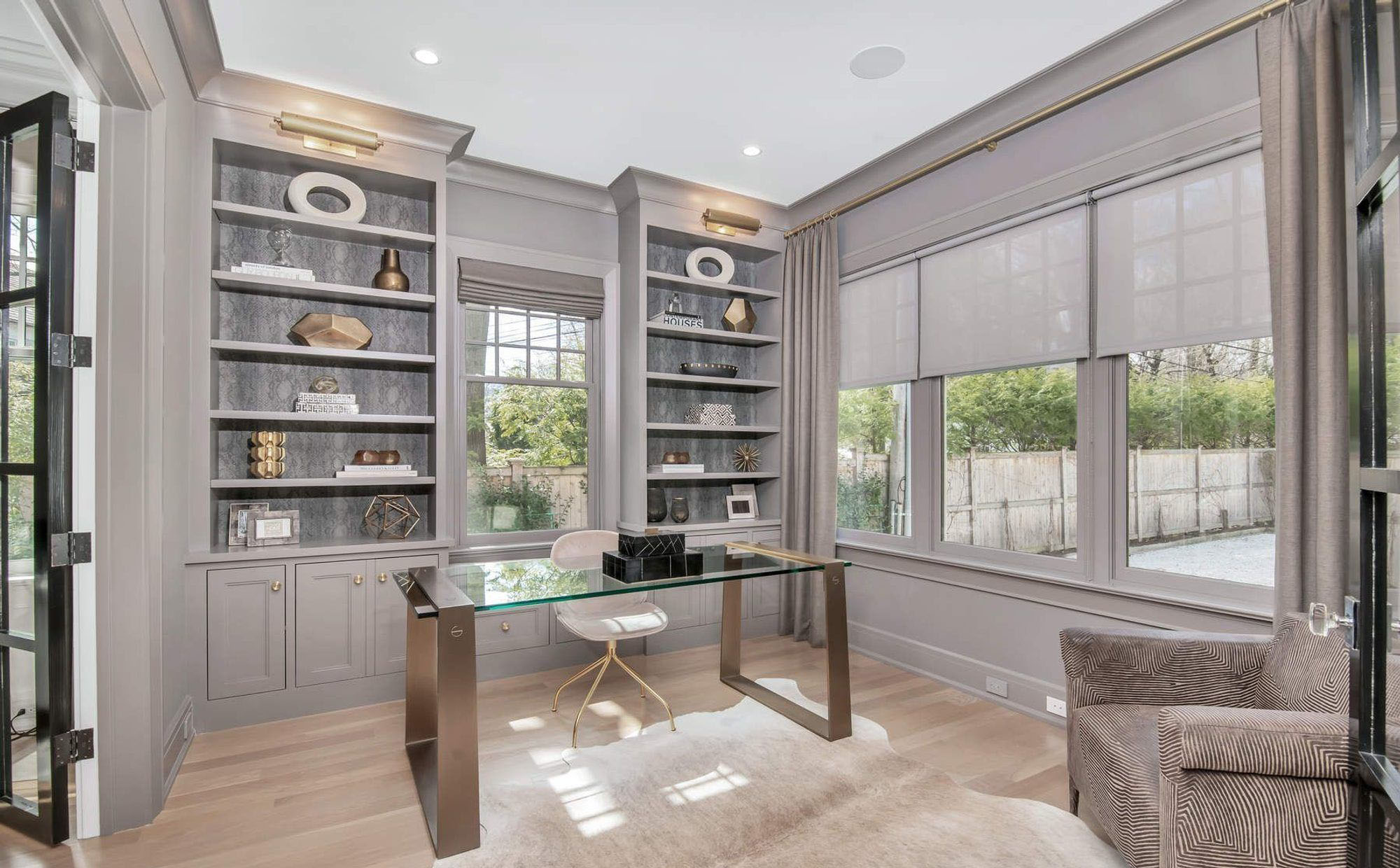 warm gray monochromatic home office color scheme with bronze gold metal finishes
