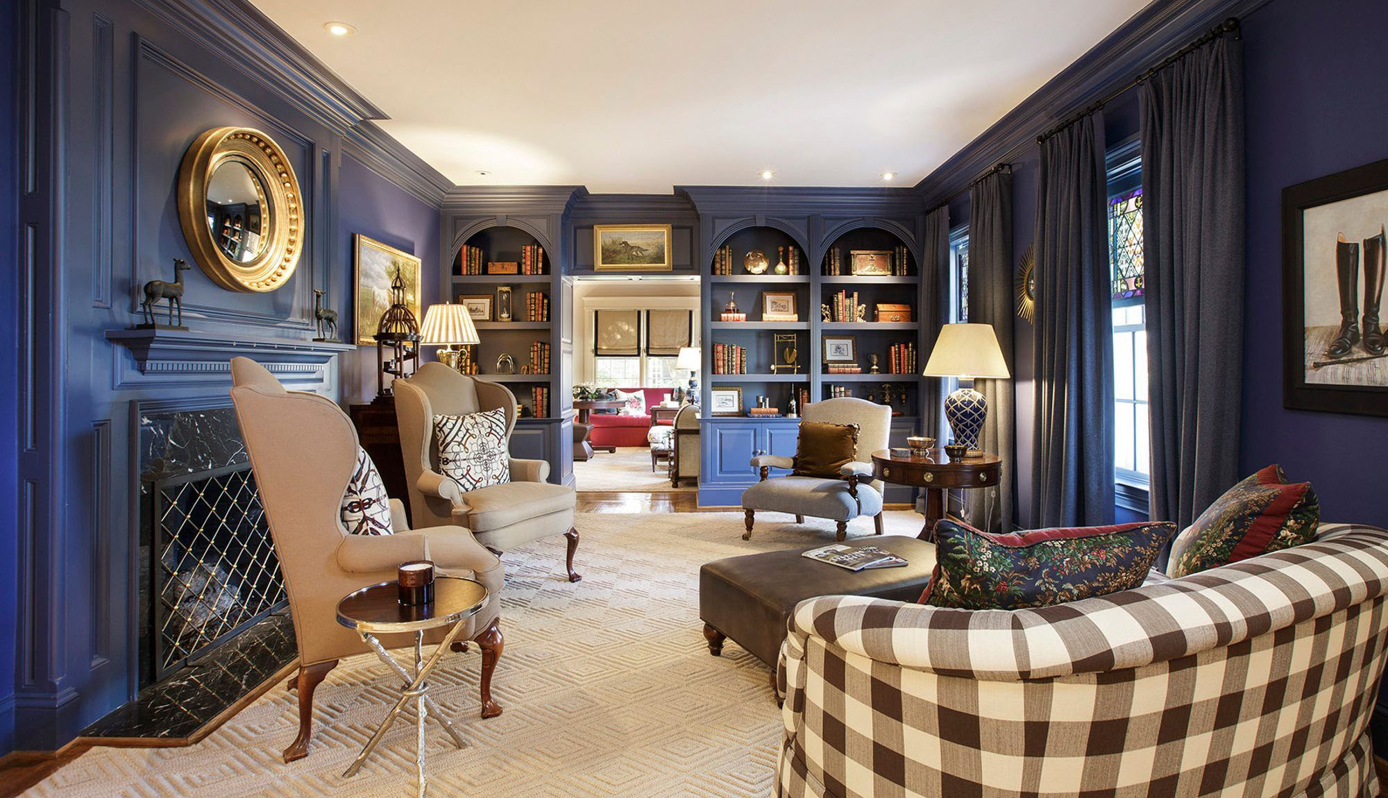 Monochromatic blue sitting room with built ins and blue fireplace surround. Brown secondary colors with a variety of materials and textures.