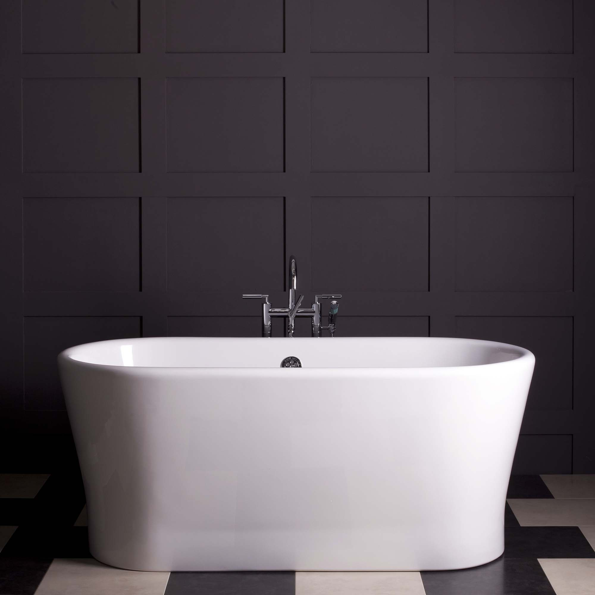 monochromatic bathroom color scheme with dark gray wall paneling, white soaking tub and matching floors