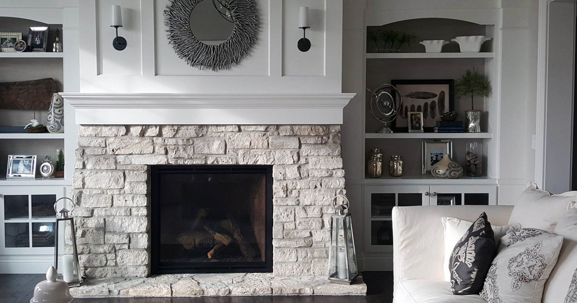 monochromatic color schemes living room light creams and white stone fireplace and built ins
