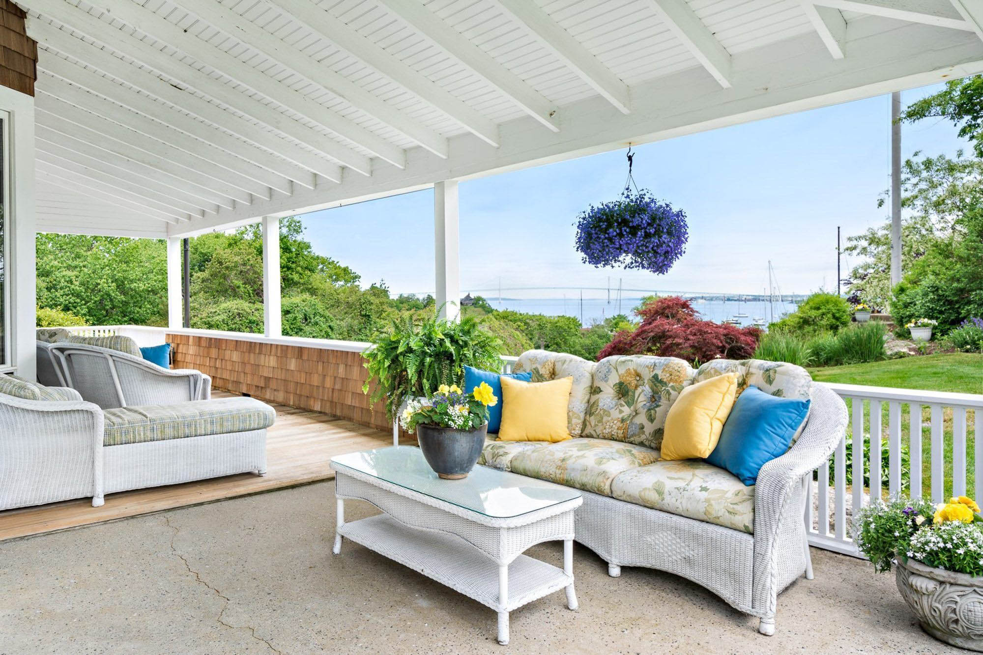 covered patio with wicker furniture and a colorful cushion print