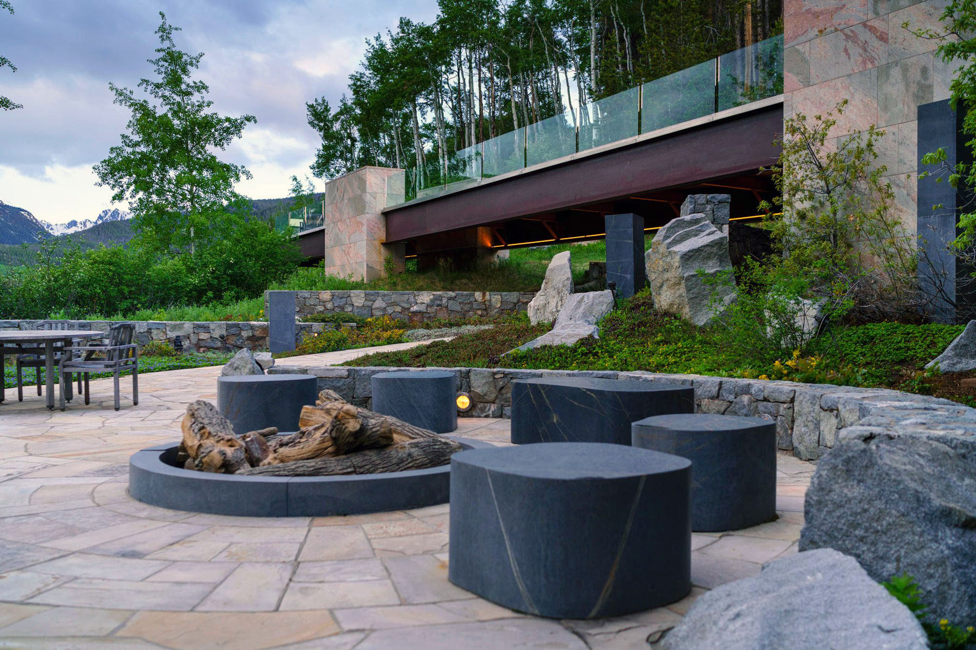 cool modern outdoor patio furniture around a fire pit