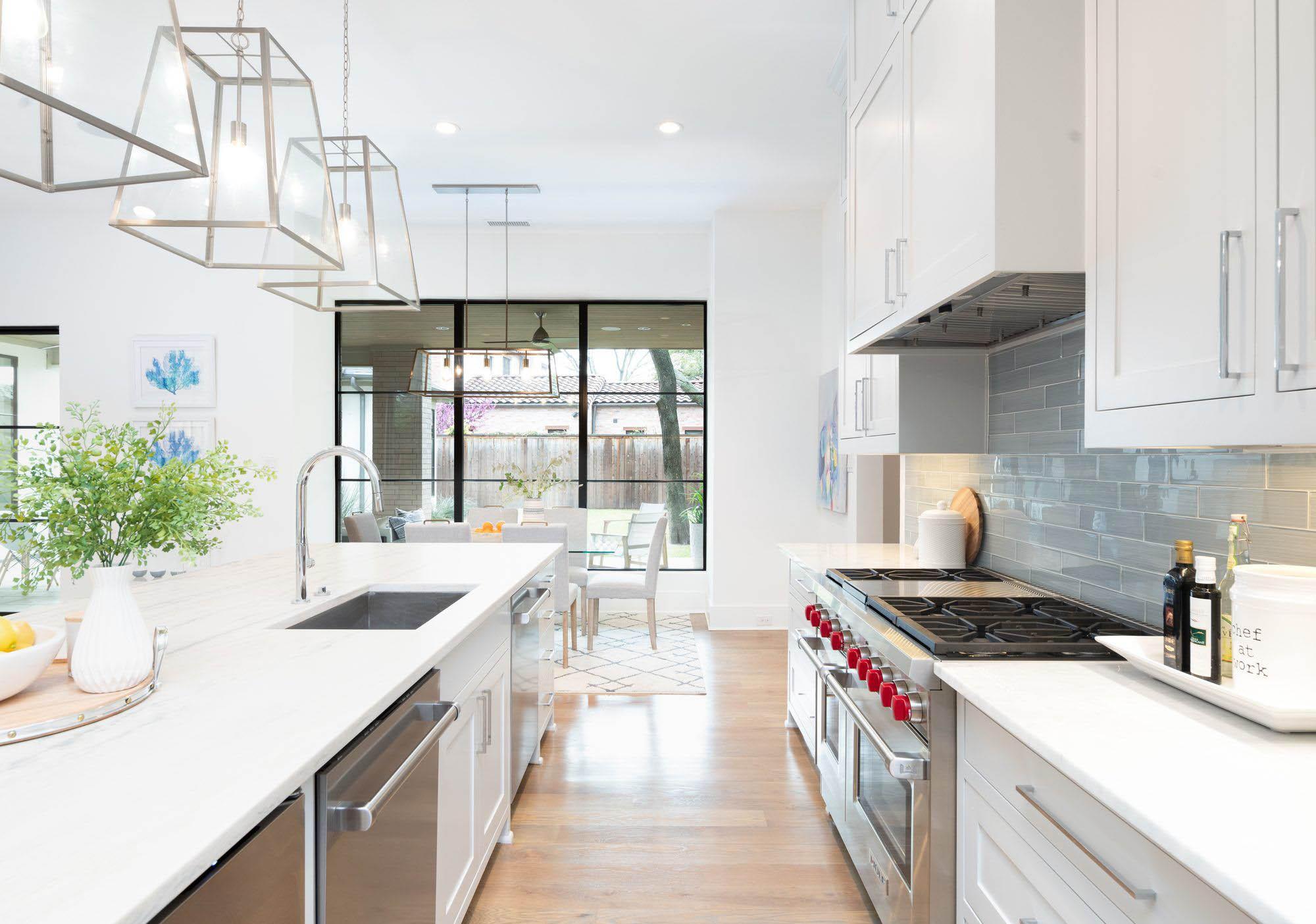 """White quartz kitchen cabinets with gray subway tile backsplash. Wolf 60"""" range with dual ovens. quartz vs granite."""