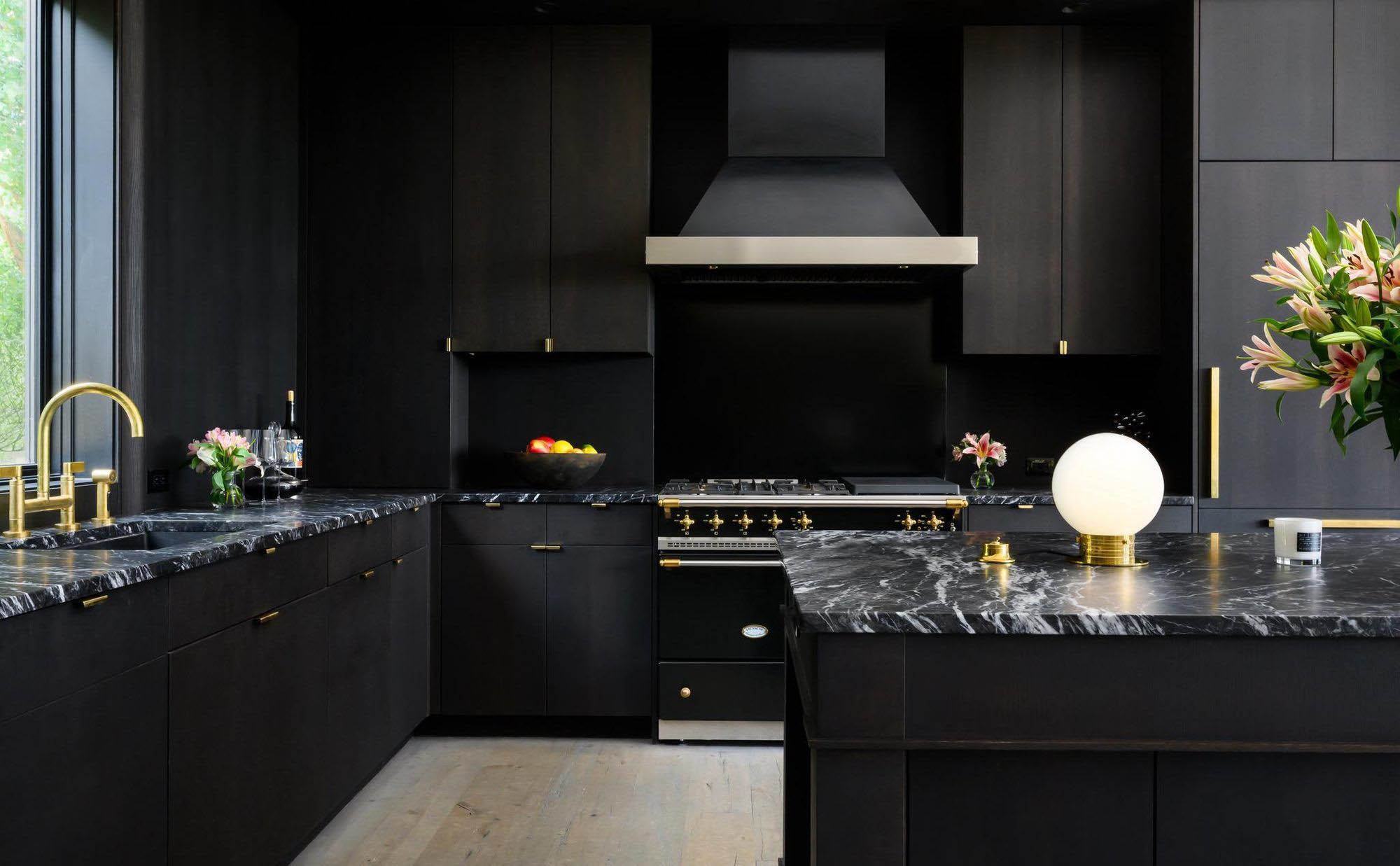 Ultra modern black and white kitchen design with Agatha black granite countertops, black cabinets and backsplash.