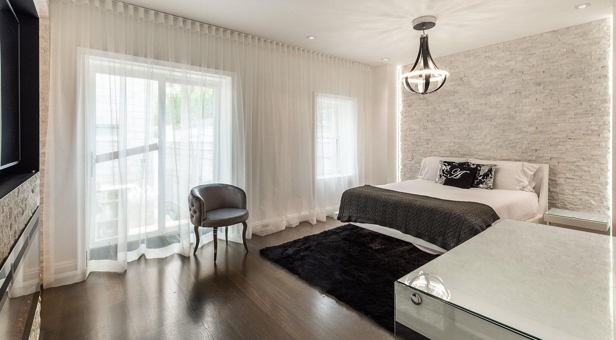 shag bedroom area rug black in a modern bedroom design