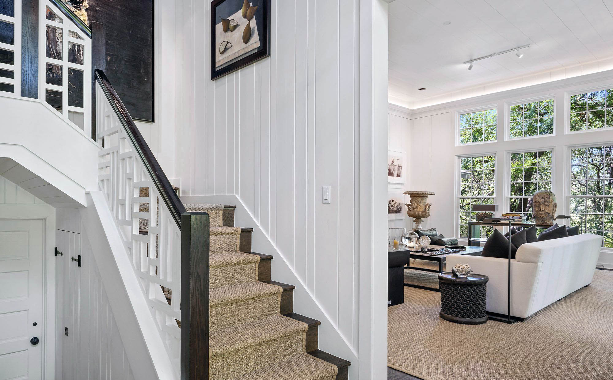 sisal grass area rug in a living room and stair runner