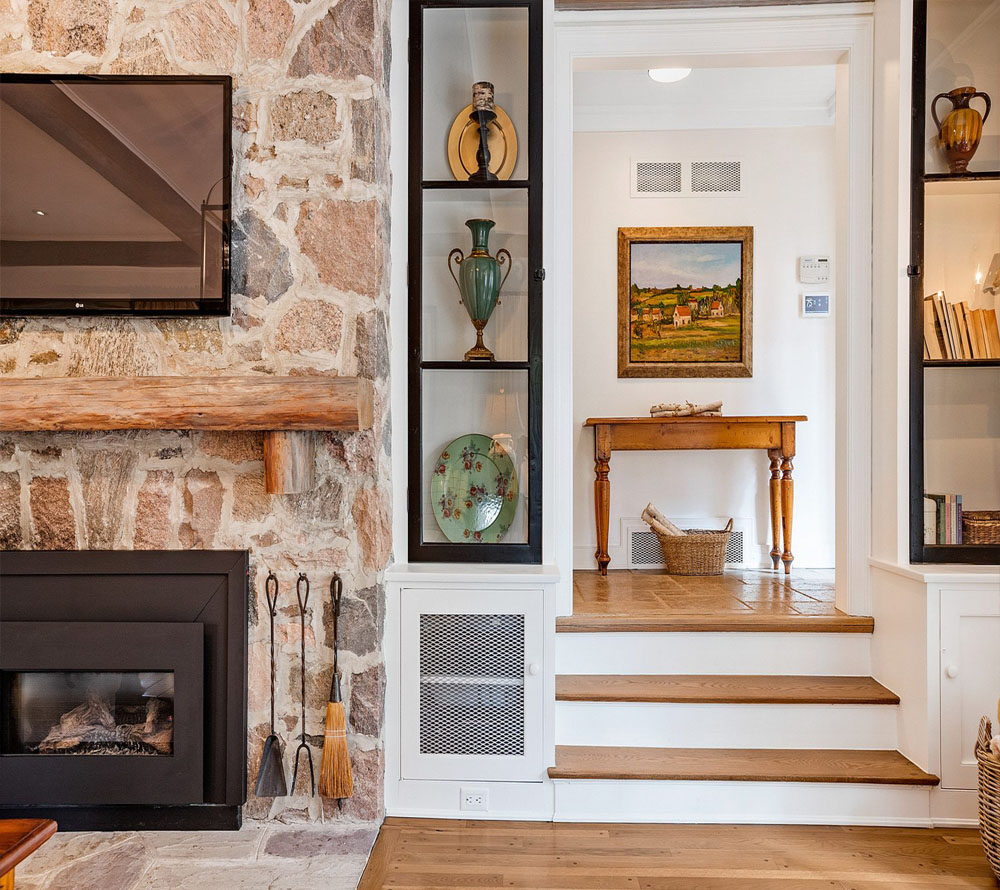 rustic fireplace with real timber shelf wood floors built ins with black frames