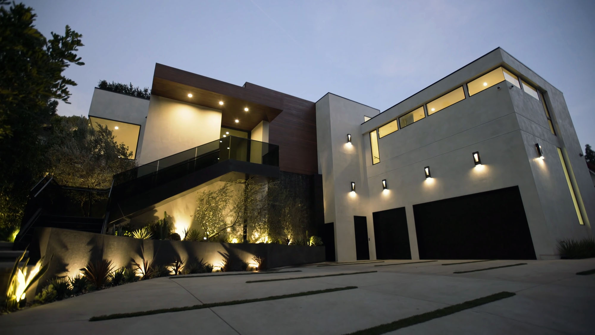 Composite decking used as an exterior siding and soffit material on a beautiful modern home.