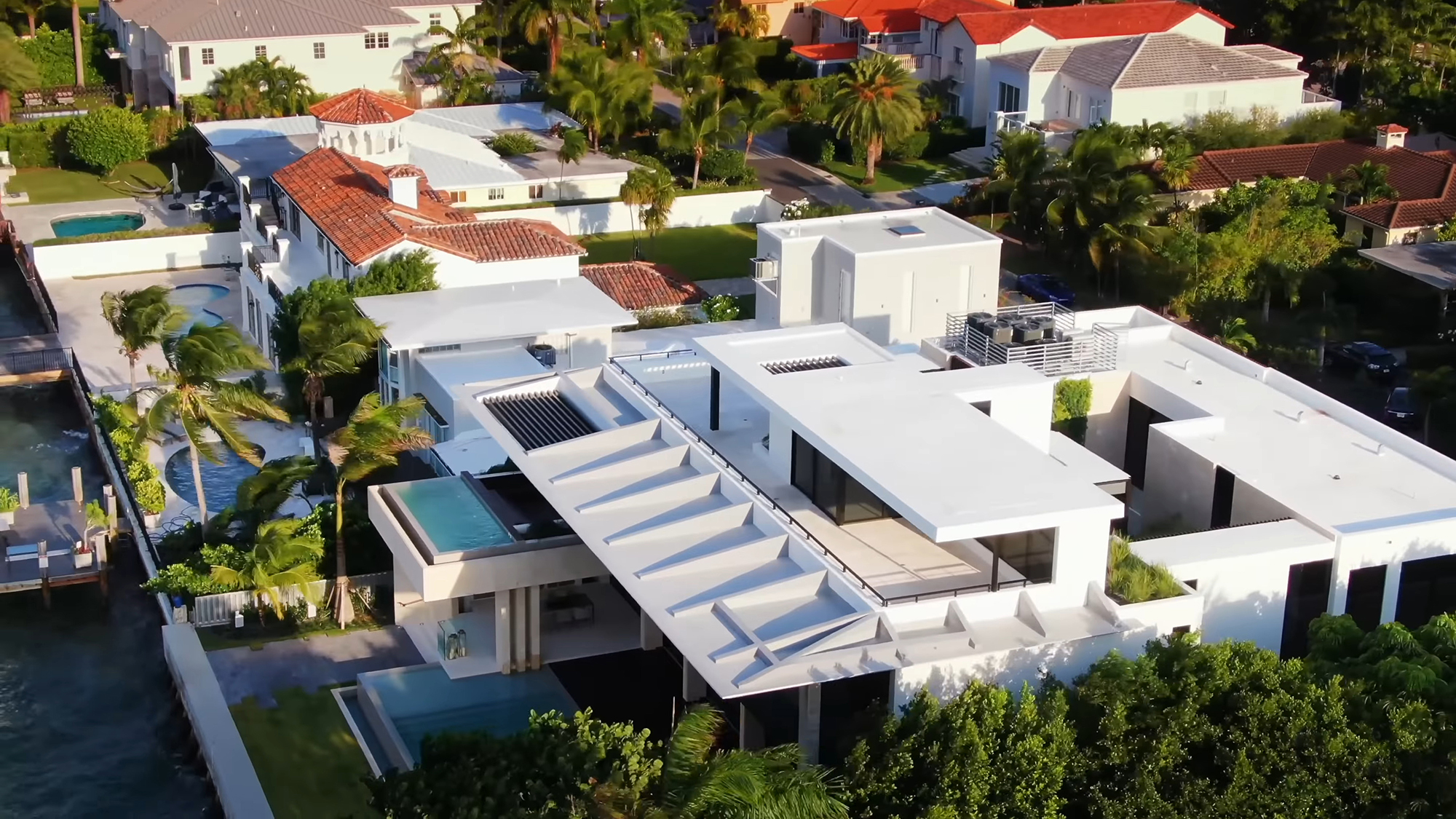 Aerial view of this beautiful flat roof custom modern home that includes a smooth fiberglass finish with built in planters, parapet walls and roof drains.