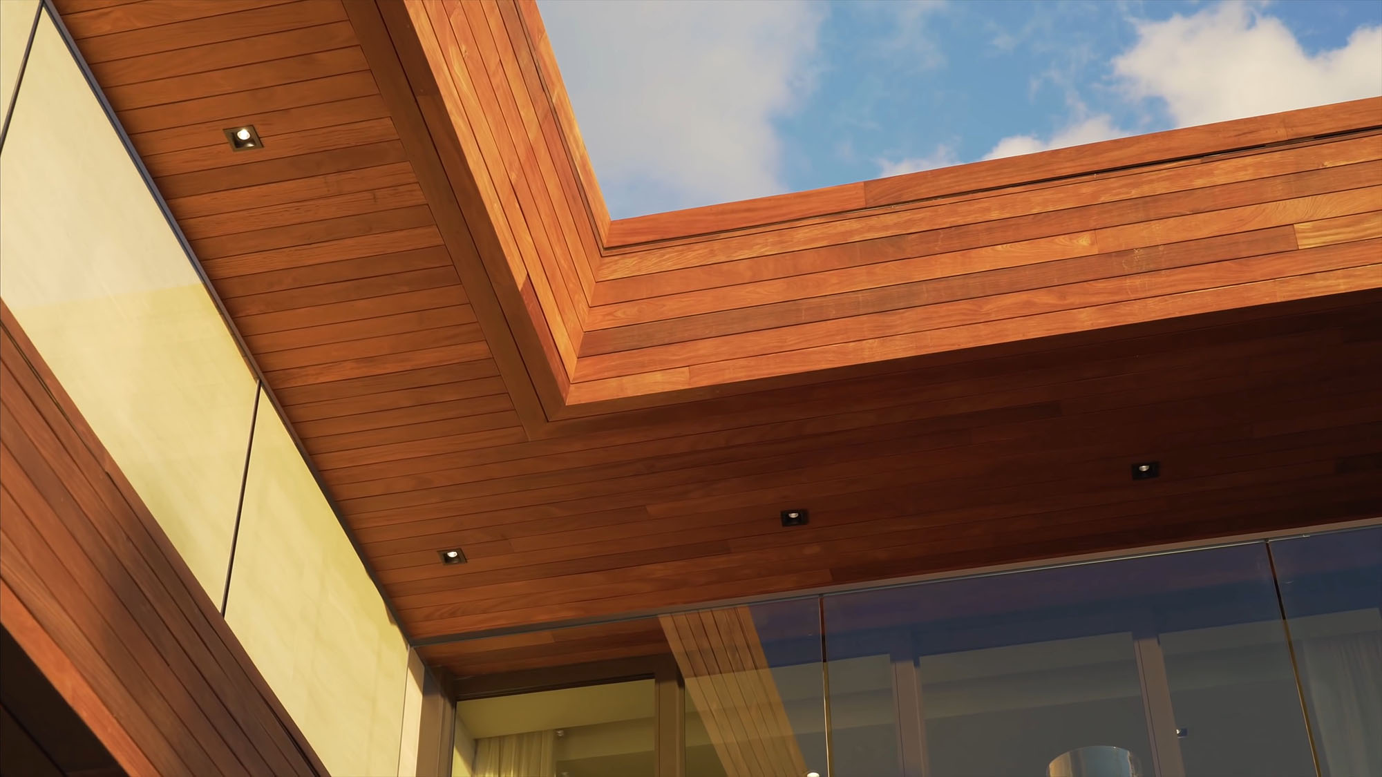 Ipe wood used as a siding and soffit material with square recessed LED lighting.