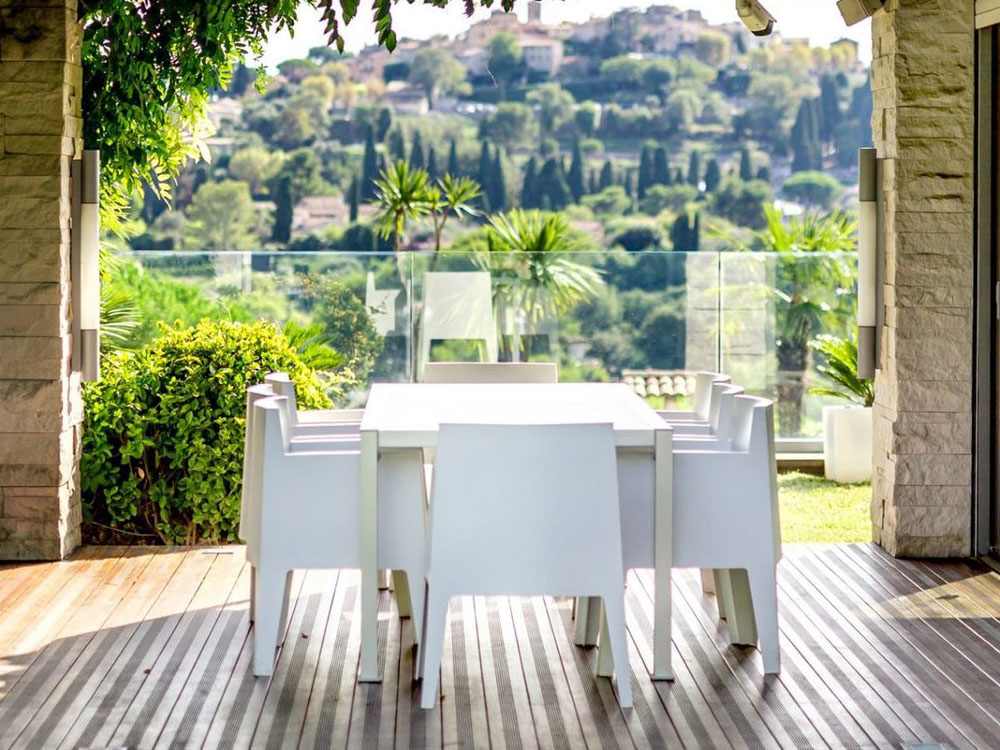 modern white outdoor dining table with matching chairs