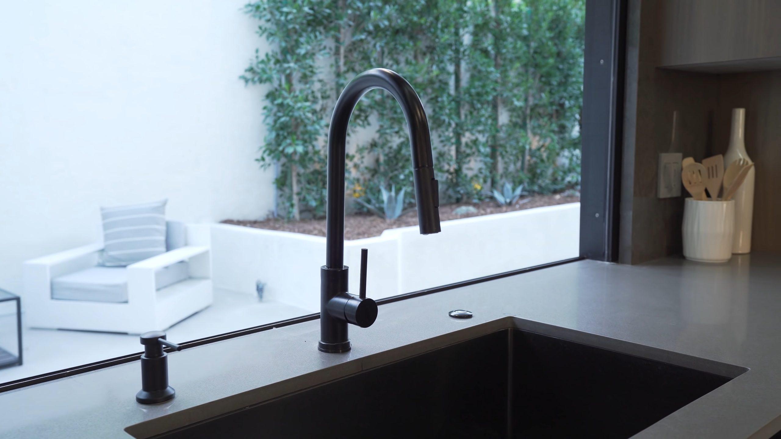 Modern metal sink with a dark black finish. black metal kitchen sink design. Modern sinks.