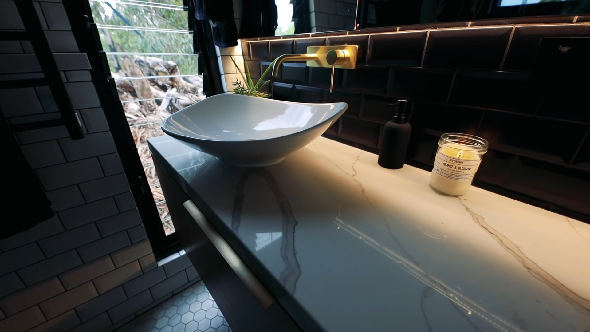 Do Tiny Houses have bathroom closeup view of the bowl sink