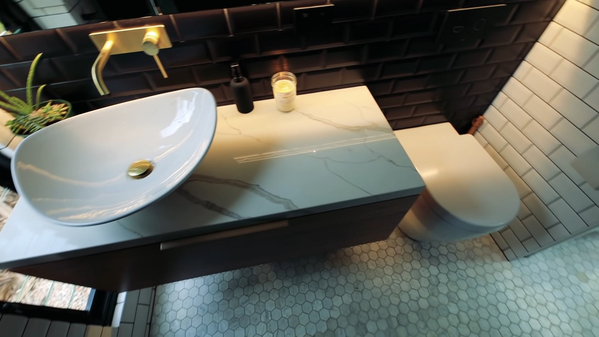 do tiny houses have bathroom view of the marble countertop bowl sink and toilet