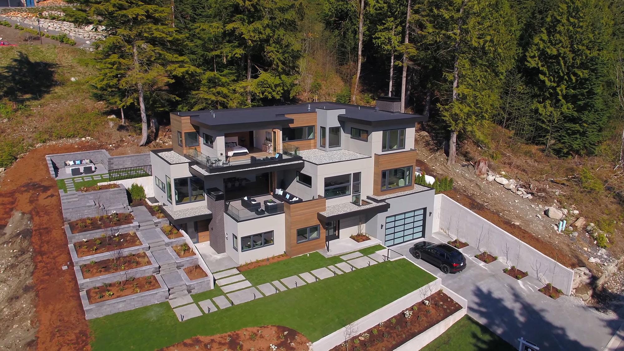 Beautiful custom built modern home using composite decking as siding.