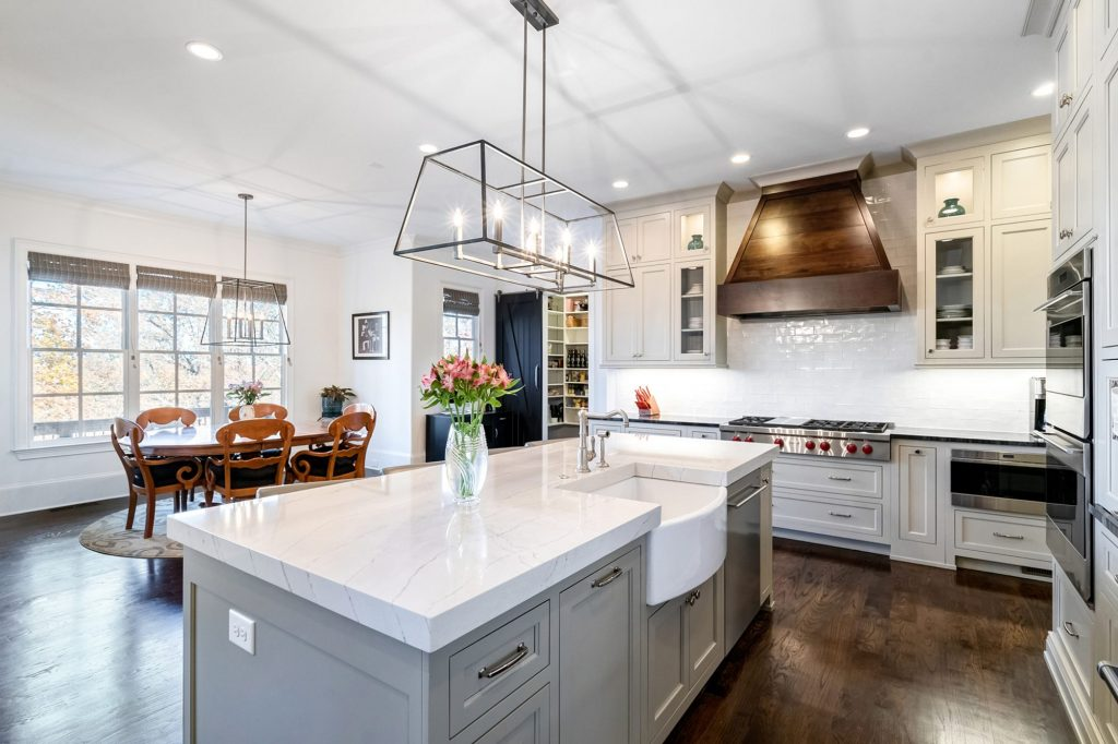 classic white farmhouse exposed apron sink in a beautiful kitchen