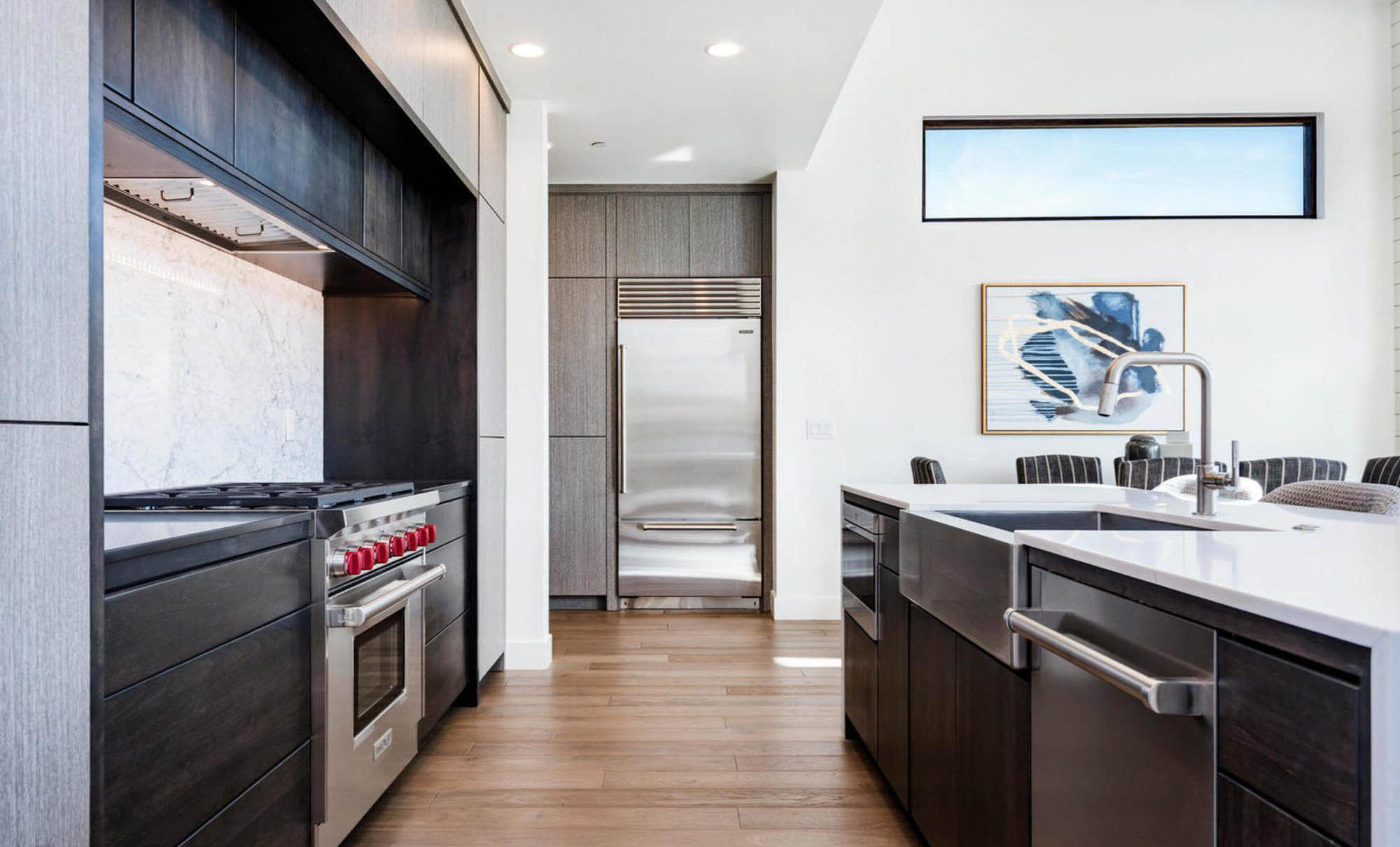ultra modern kitchen with a stainless steel farmhouse sink