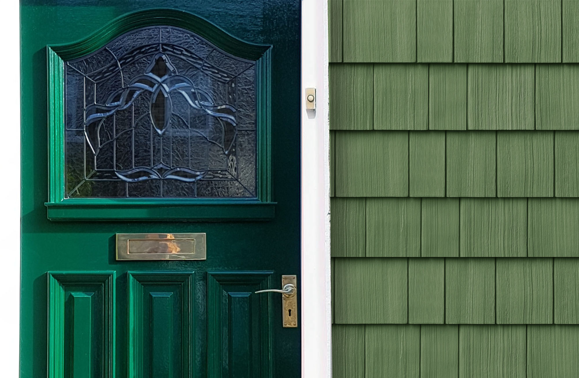 Green front door with green cedar shake siding and white trim with gold hardware.