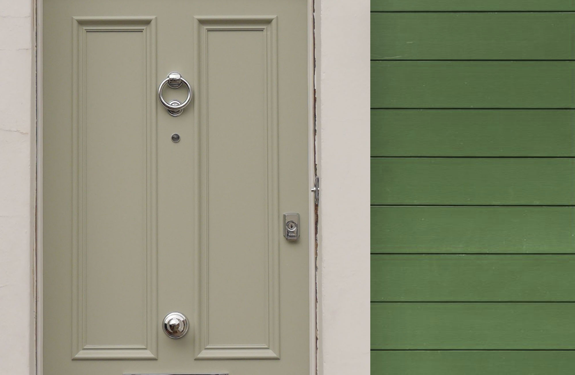 Green lap siding with a white front door and matching white trim.
