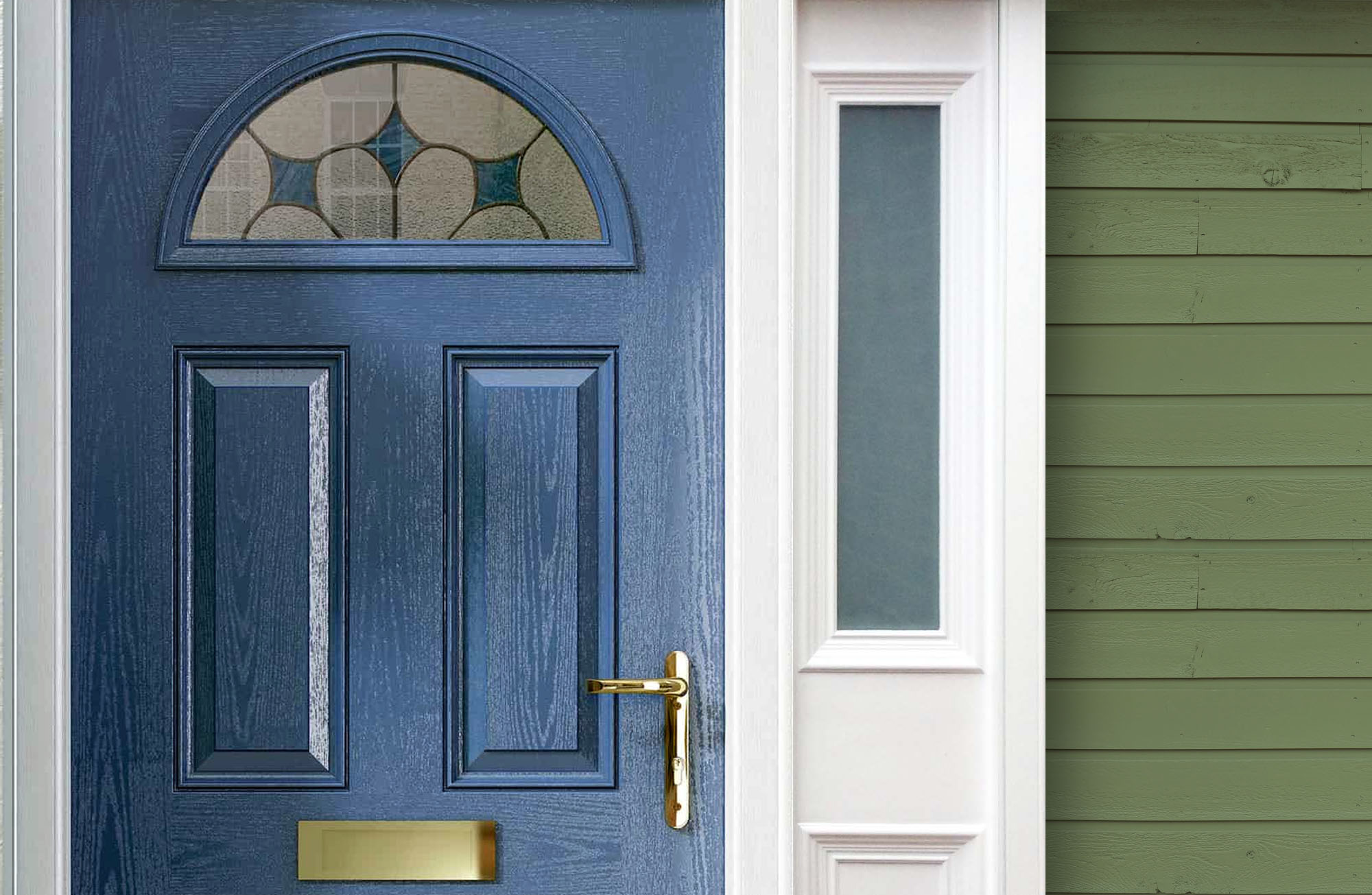 This beautiful blue home features green siding, a deep blue front door and white trim with gold hardware.