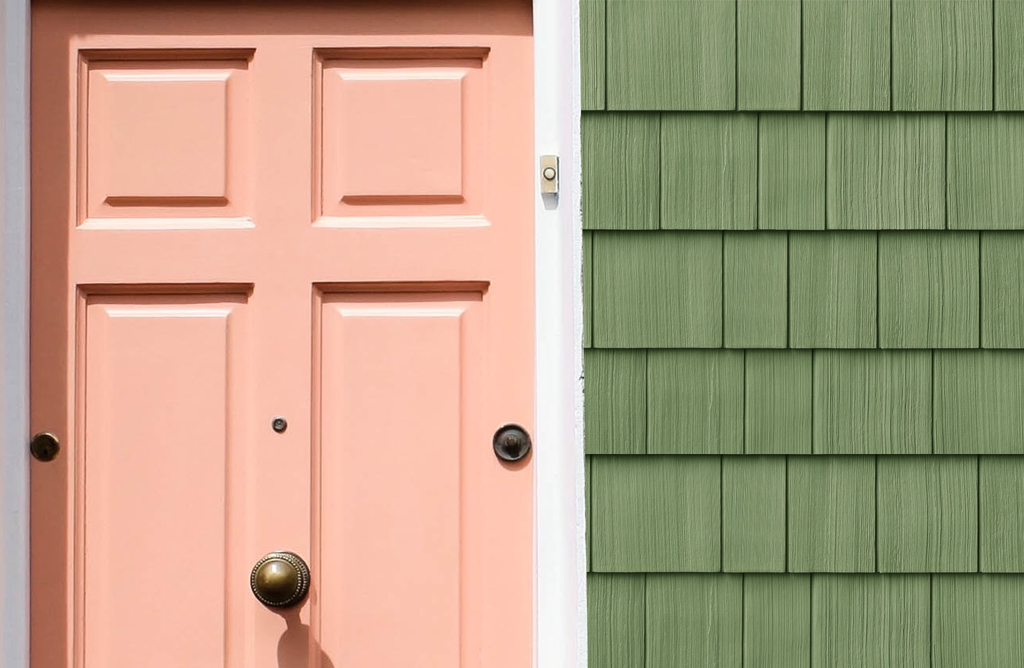Green cedar shake siding with a salmon colored front door.