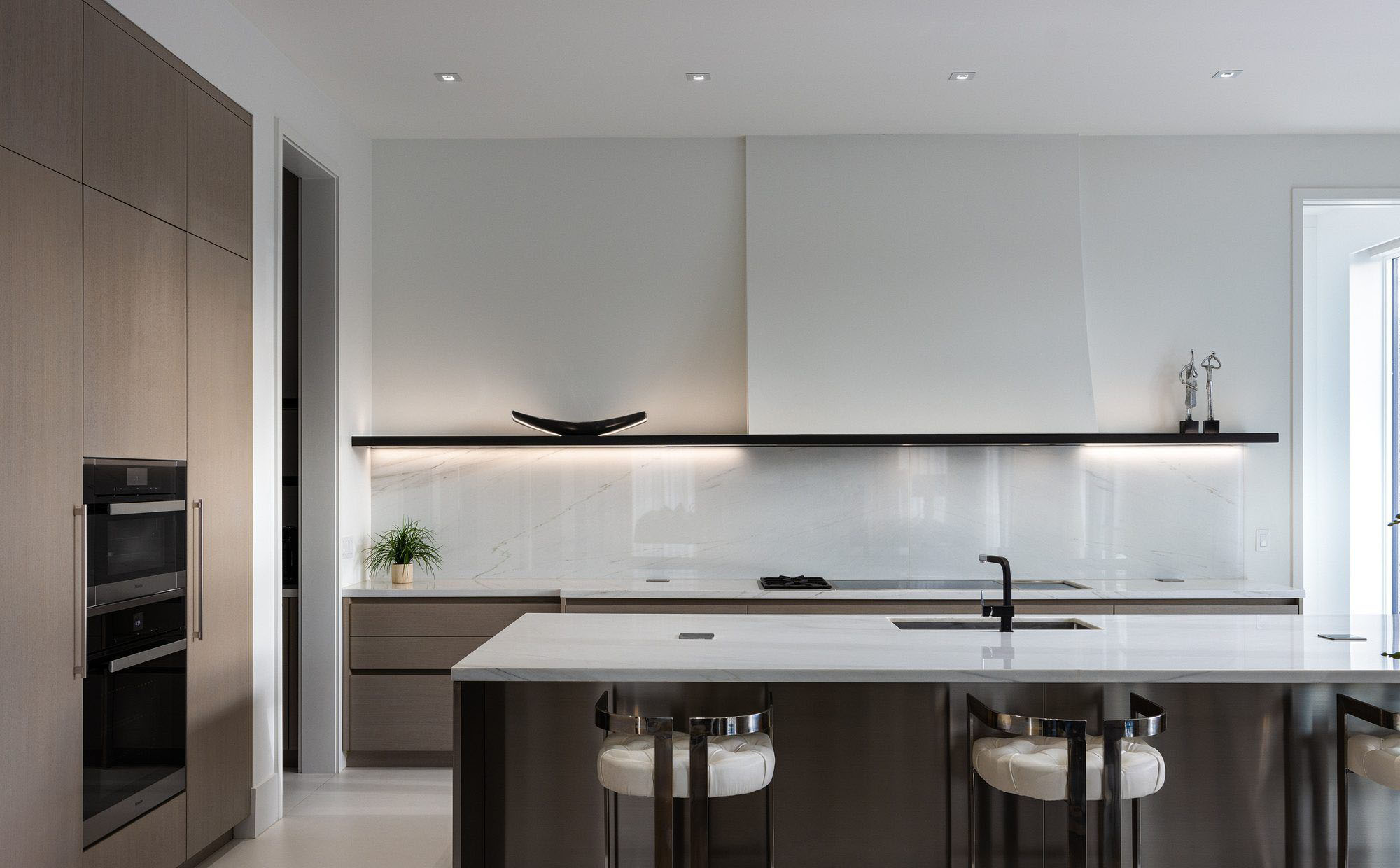 "Stunning modern kitchen with 4"" recessed LED lights and a square trim kit. Modern home design details."