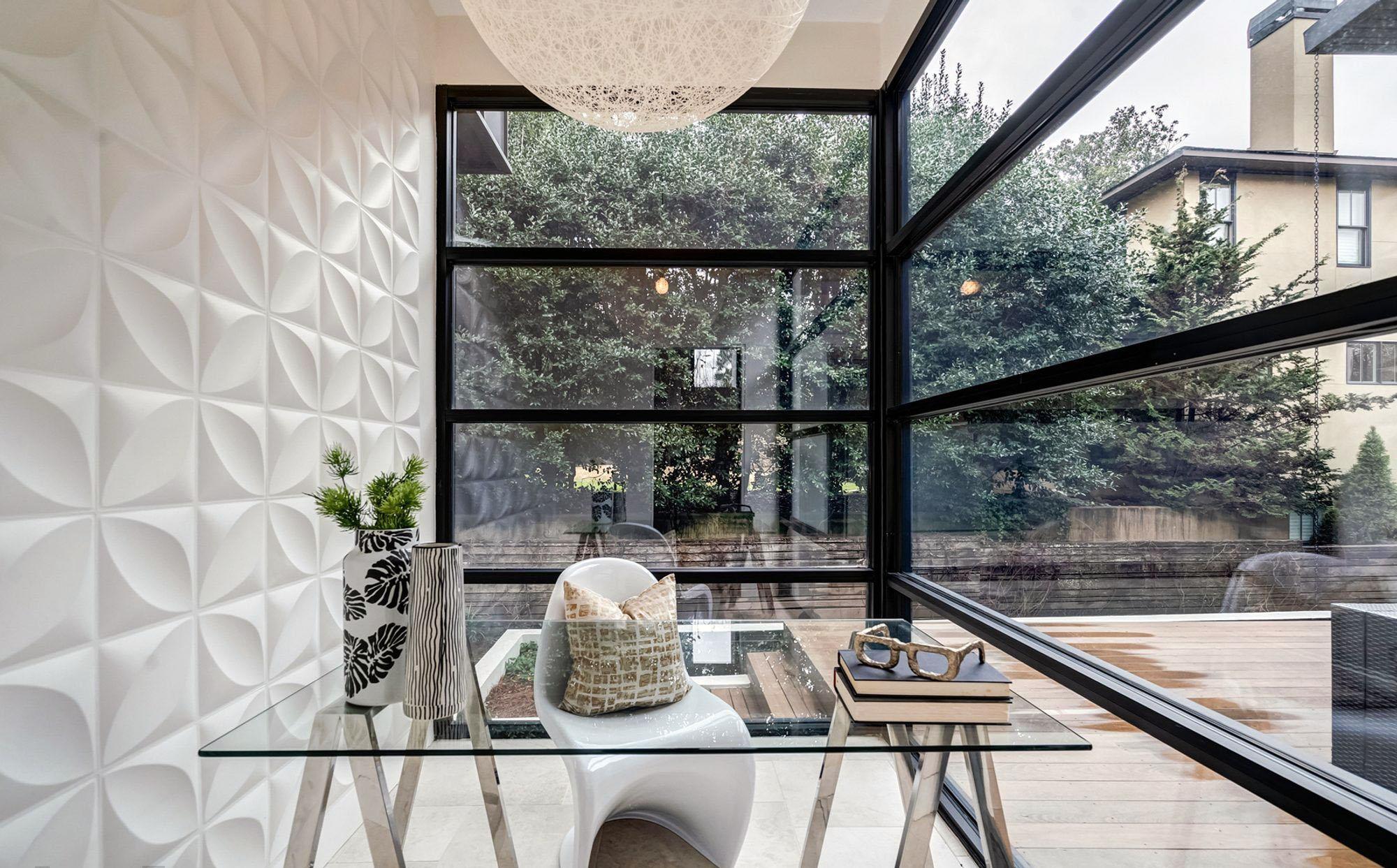 Modern office with walls of glass. Corner windows.