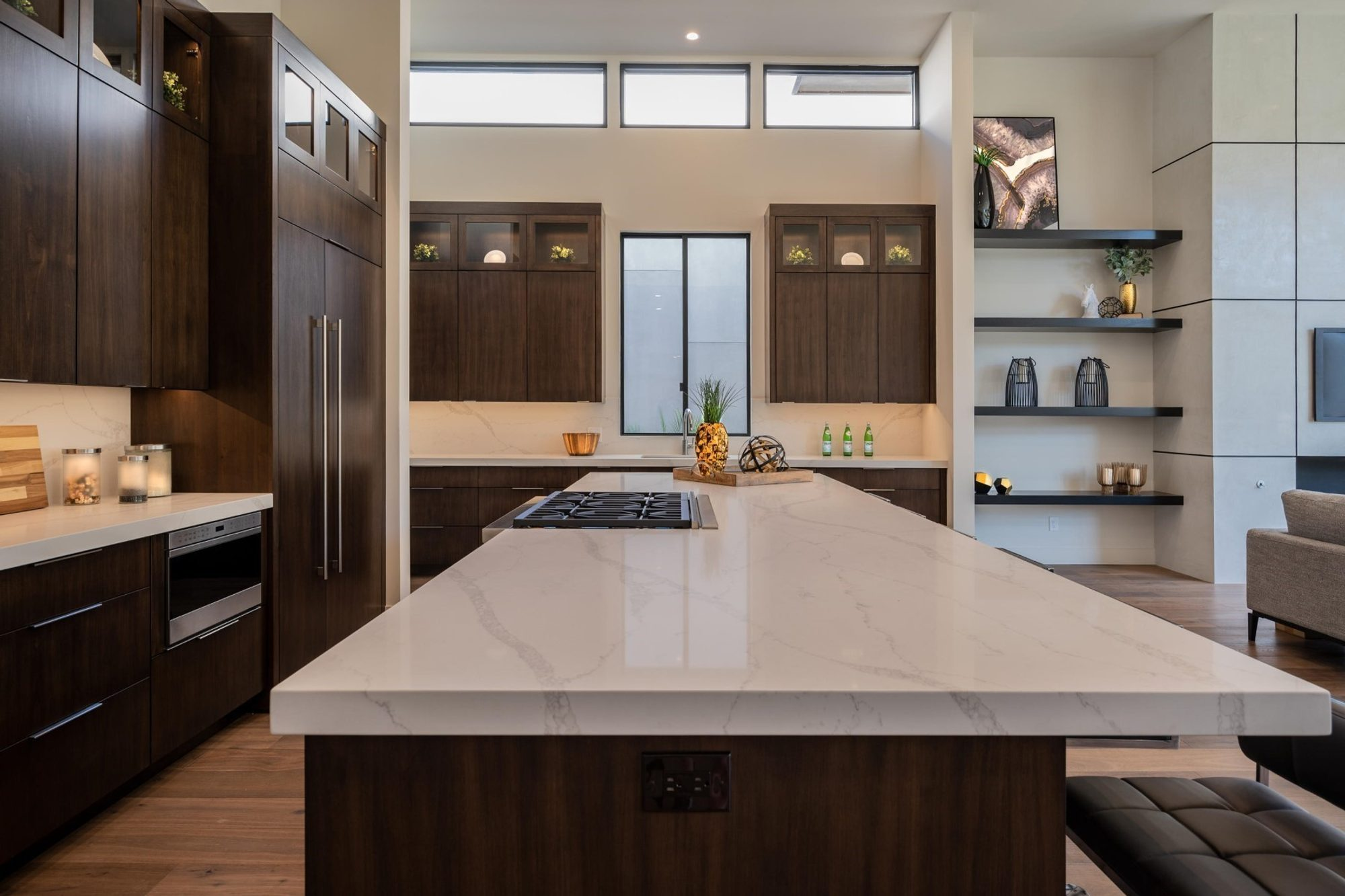 Beautiful modern kitchen with extra high 12' ceilings. Modern wood cabinets with quartz marble countertops.