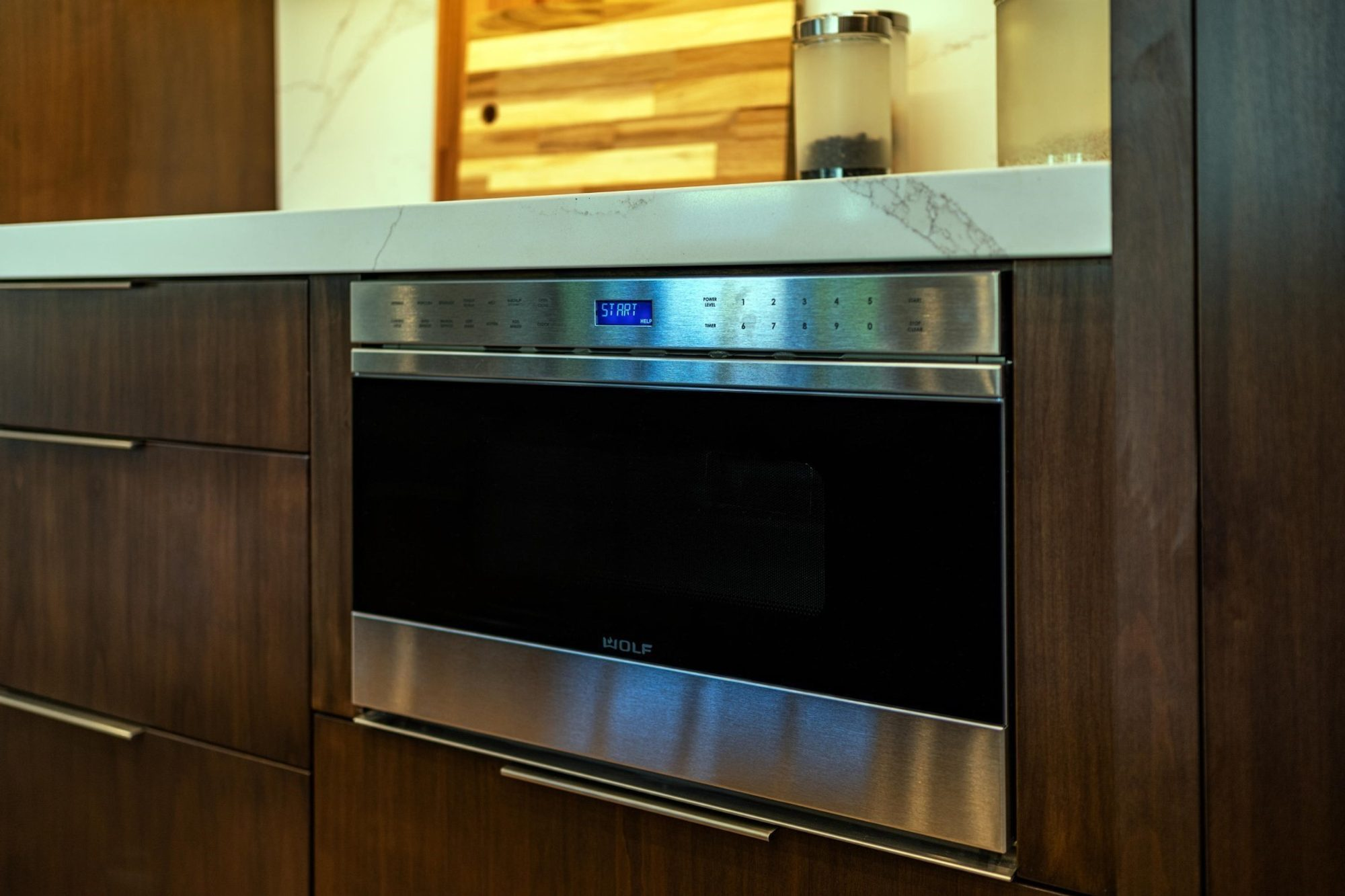 Modern kitchen with built in stainless steel appliances. Real wood flat faced cabinets.