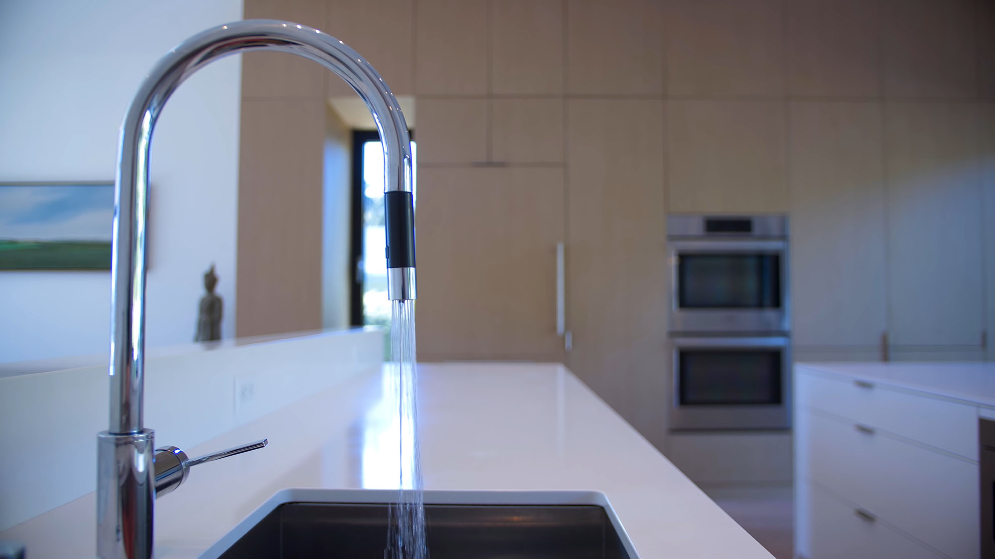 Closeup view of a modern chrome faucet with touch controls. modern home design details.