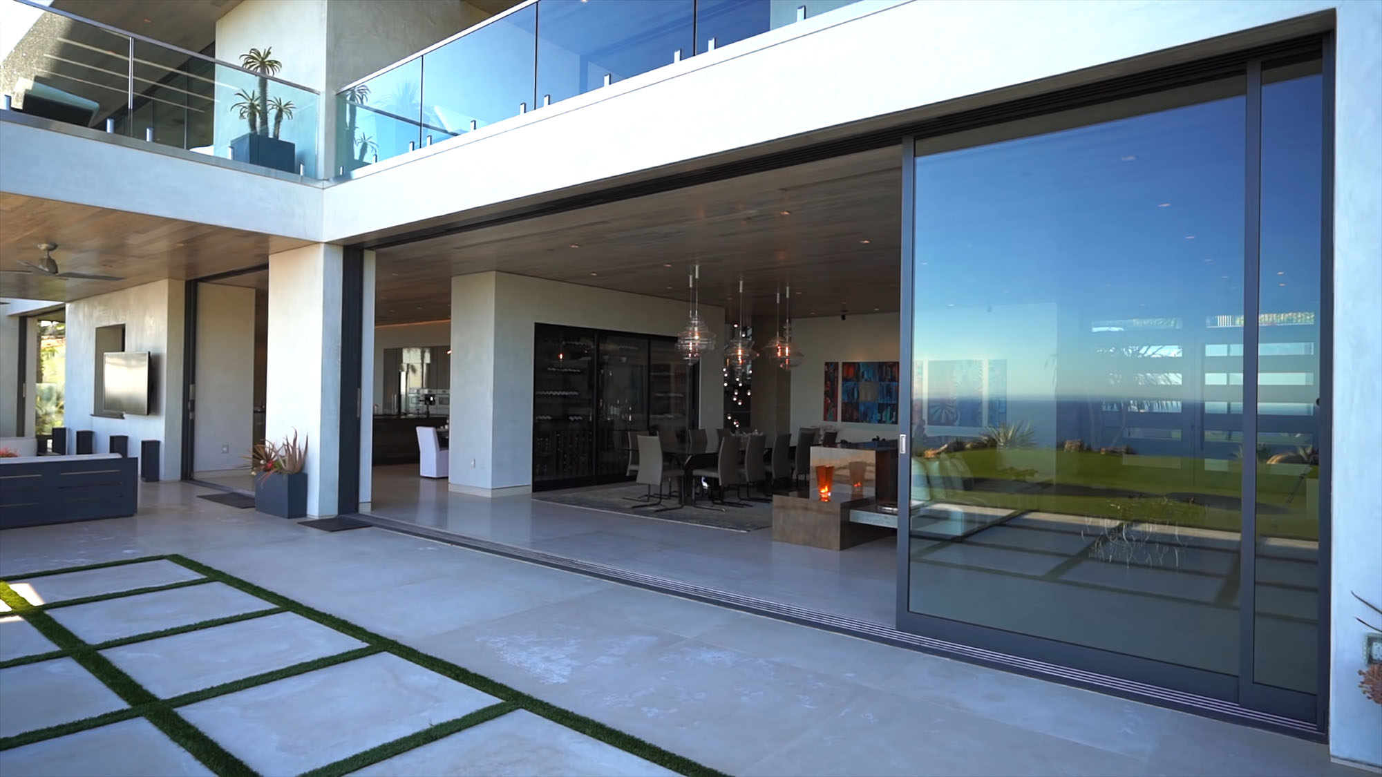Huge gliding glass doors recessed into the side walls.