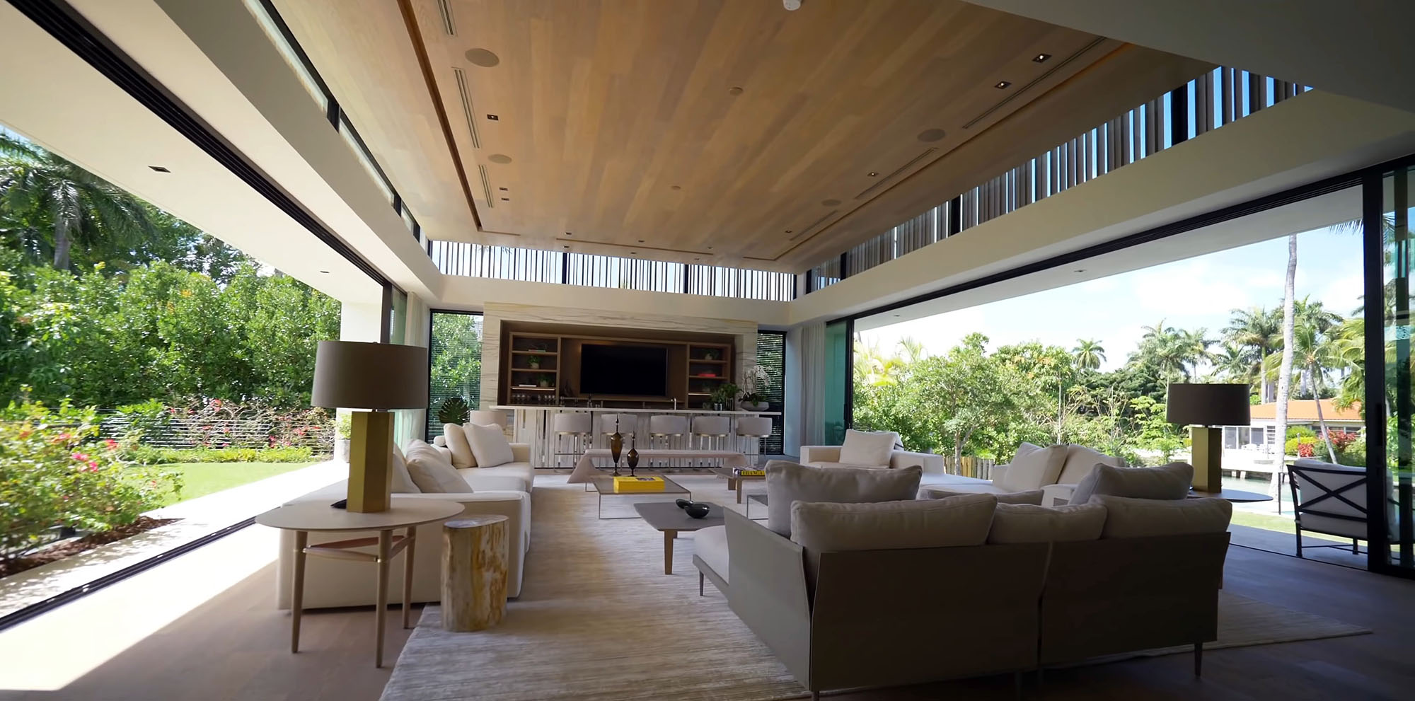 Modern home with an indoor outdoor design and walls of glass. Gliding glass doors.