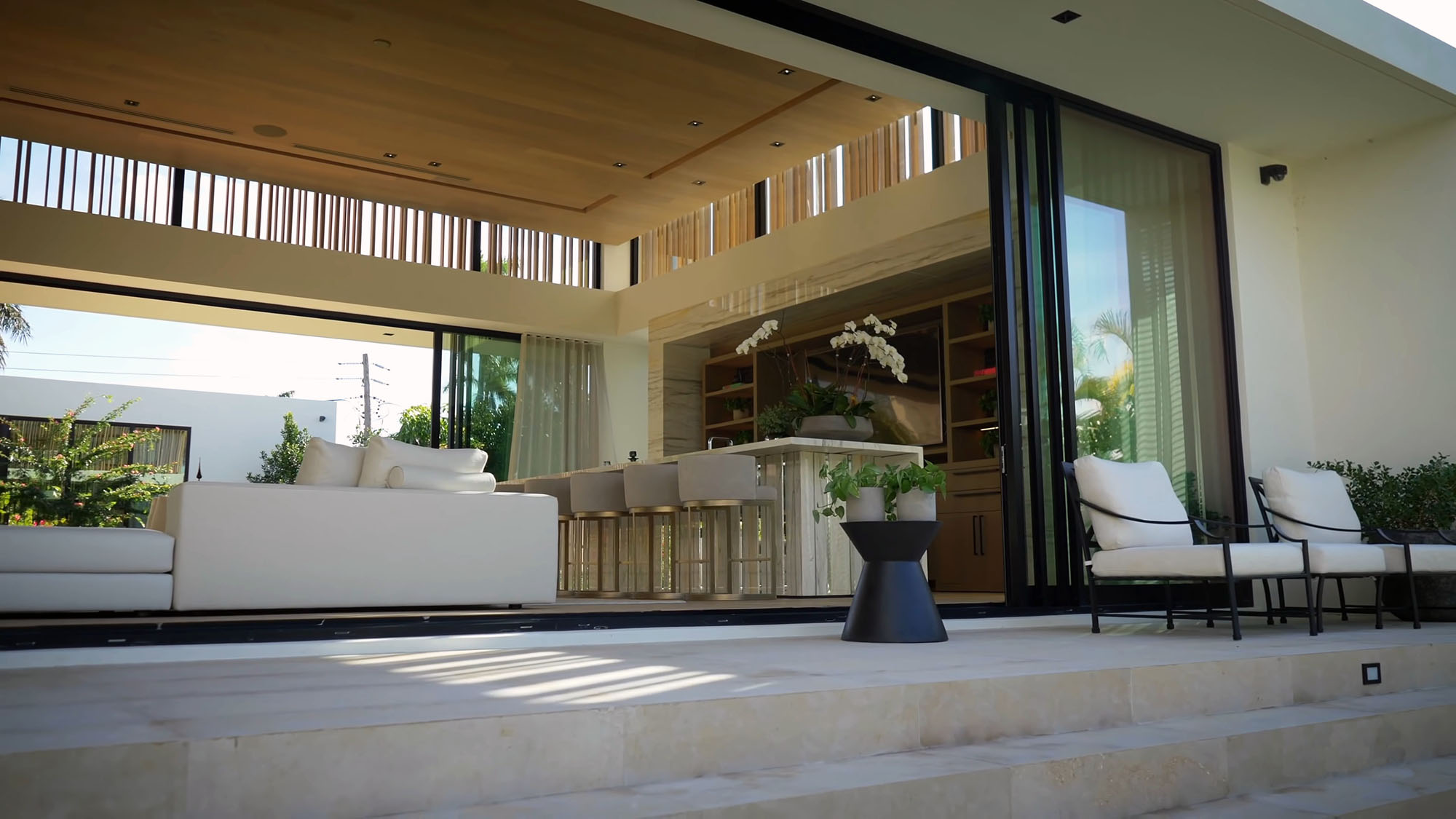 Modern gliding patio doors fully opened.