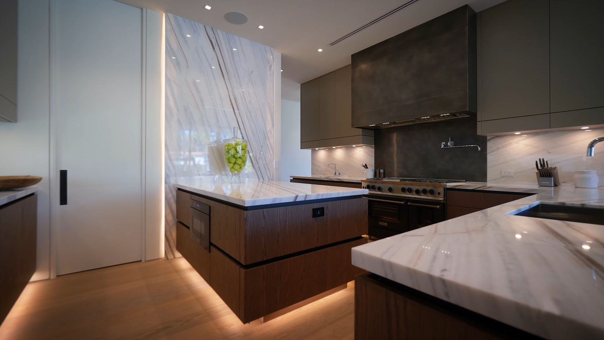 modern home design details. Beautiful luxury kitchen design with a modern feel. Flat faced cabinetry, with solid slab backsplash and lots of marble.