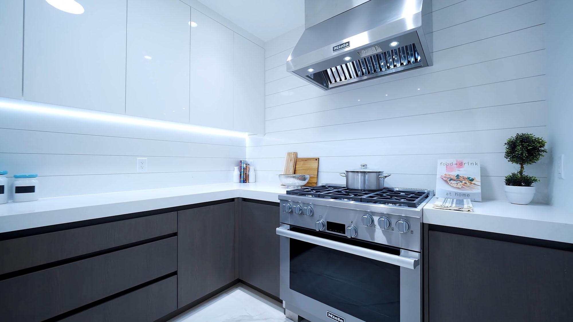 Miele full size range in an ultra modern prep kitchen.