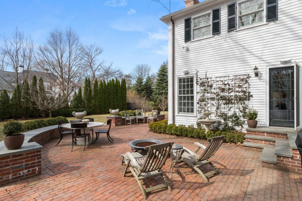 Red brick backyard patio with brick walls. Limestone steps.