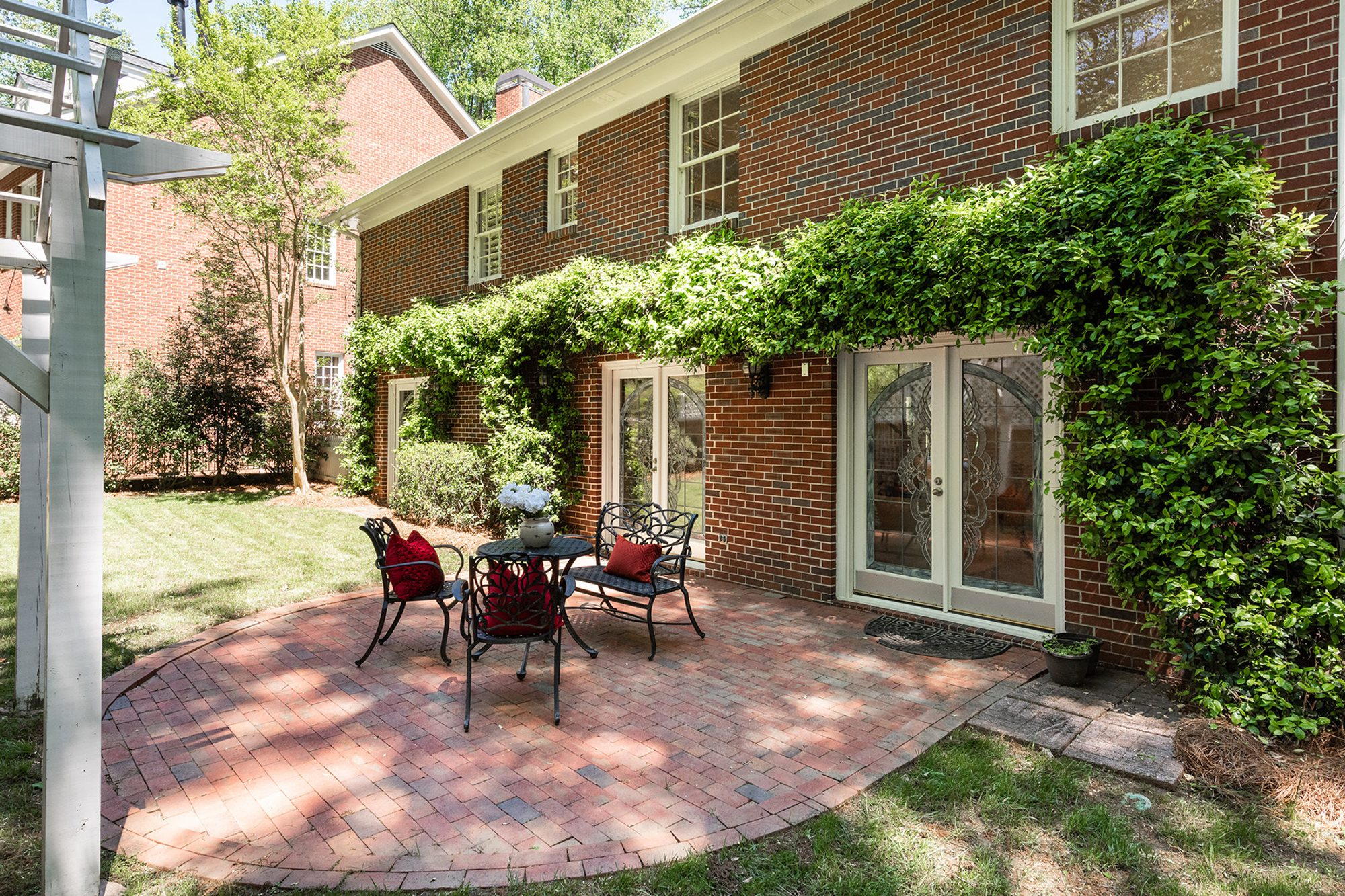 Simple red brick patio with a subway style pattern and brick border.