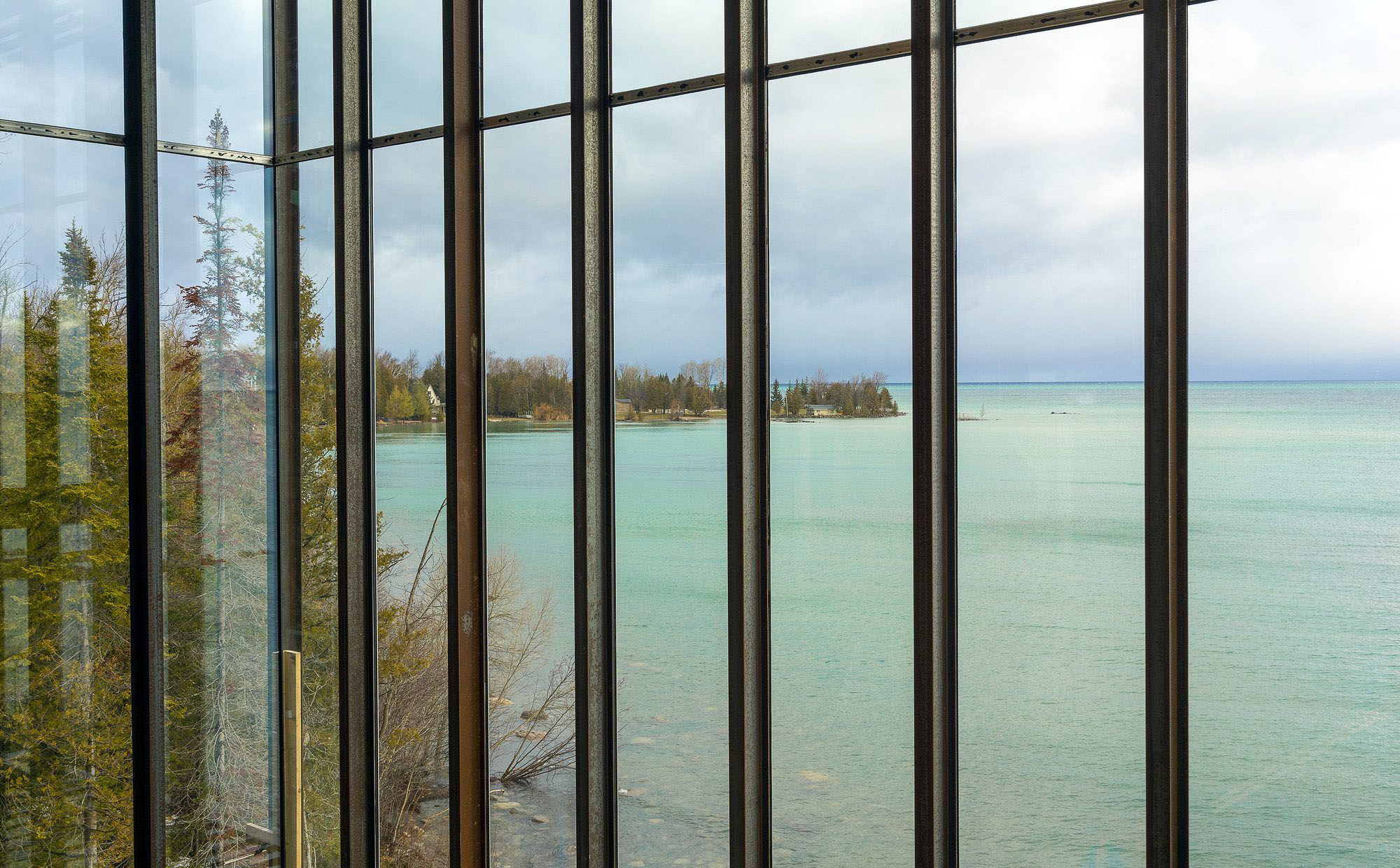 Modern windows with a beautiful water view. Closeup view through the windows.