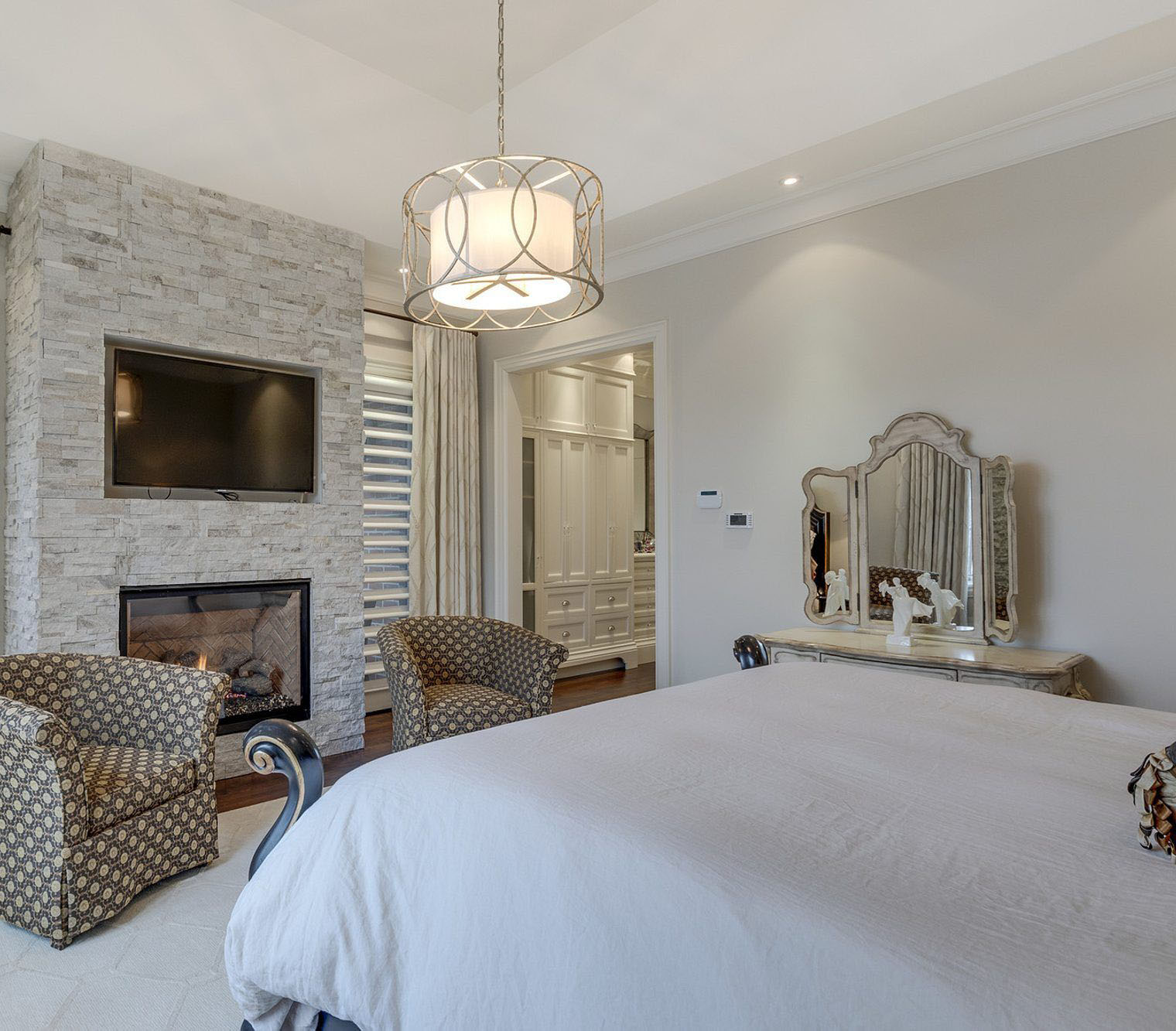 White ledgestone used to build a fireplace surround is a modern look that works well in a bedroom. fireplace design ideas.