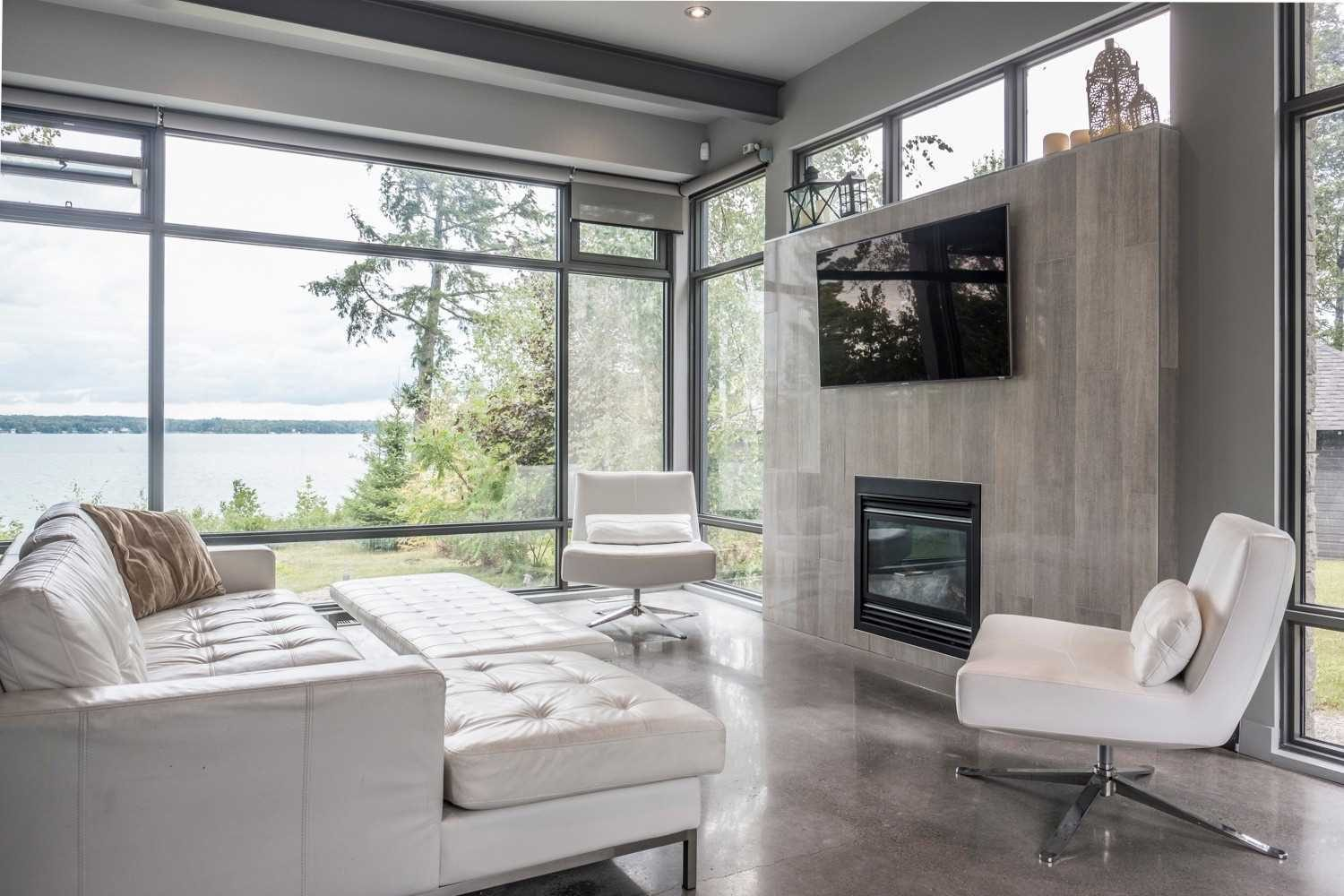 Ultra modern bedroom fireplace surround built with gray tile.