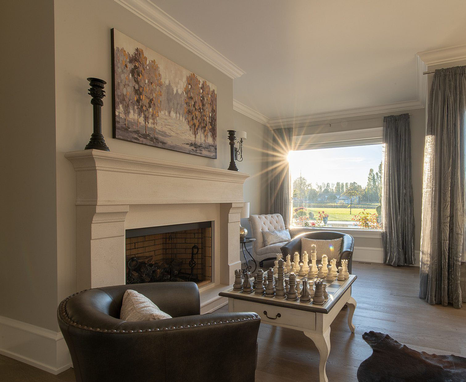 Cast cement wood burning fireplace surround in the bedroom. Warm cream colored paint with gray walls and white trim. fireplace design ideas.