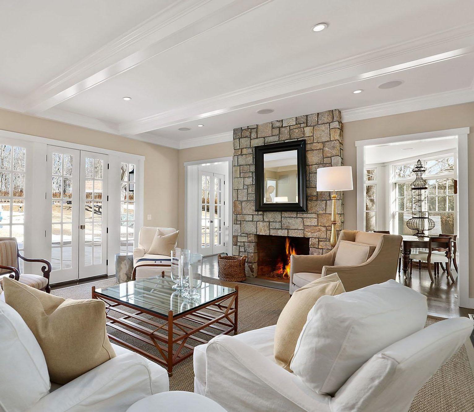 Real stone wood burning fireplace surround with polished concrete floors.